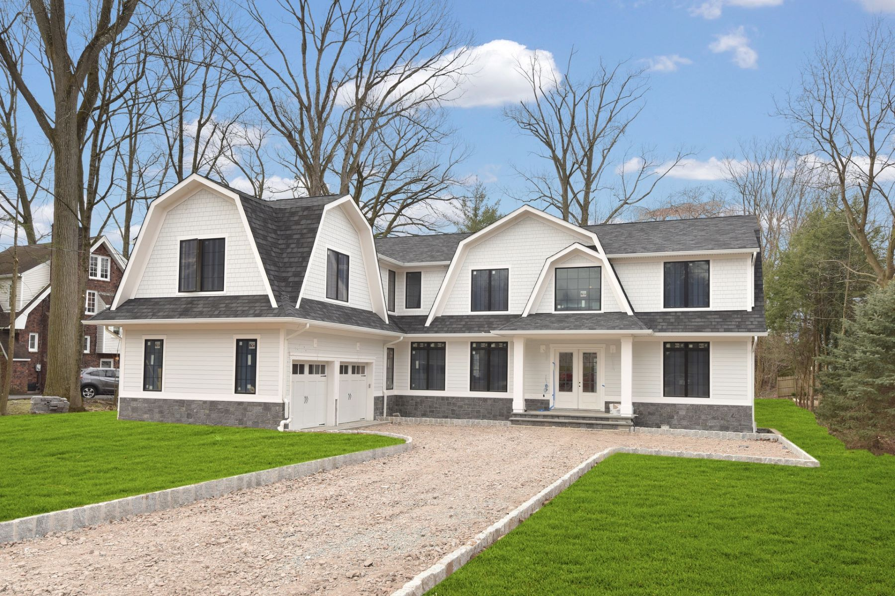 Single Family Homes for Sale at Hampton Style Colonial 50 Forest Road Tenafly, New Jersey 07670 United States