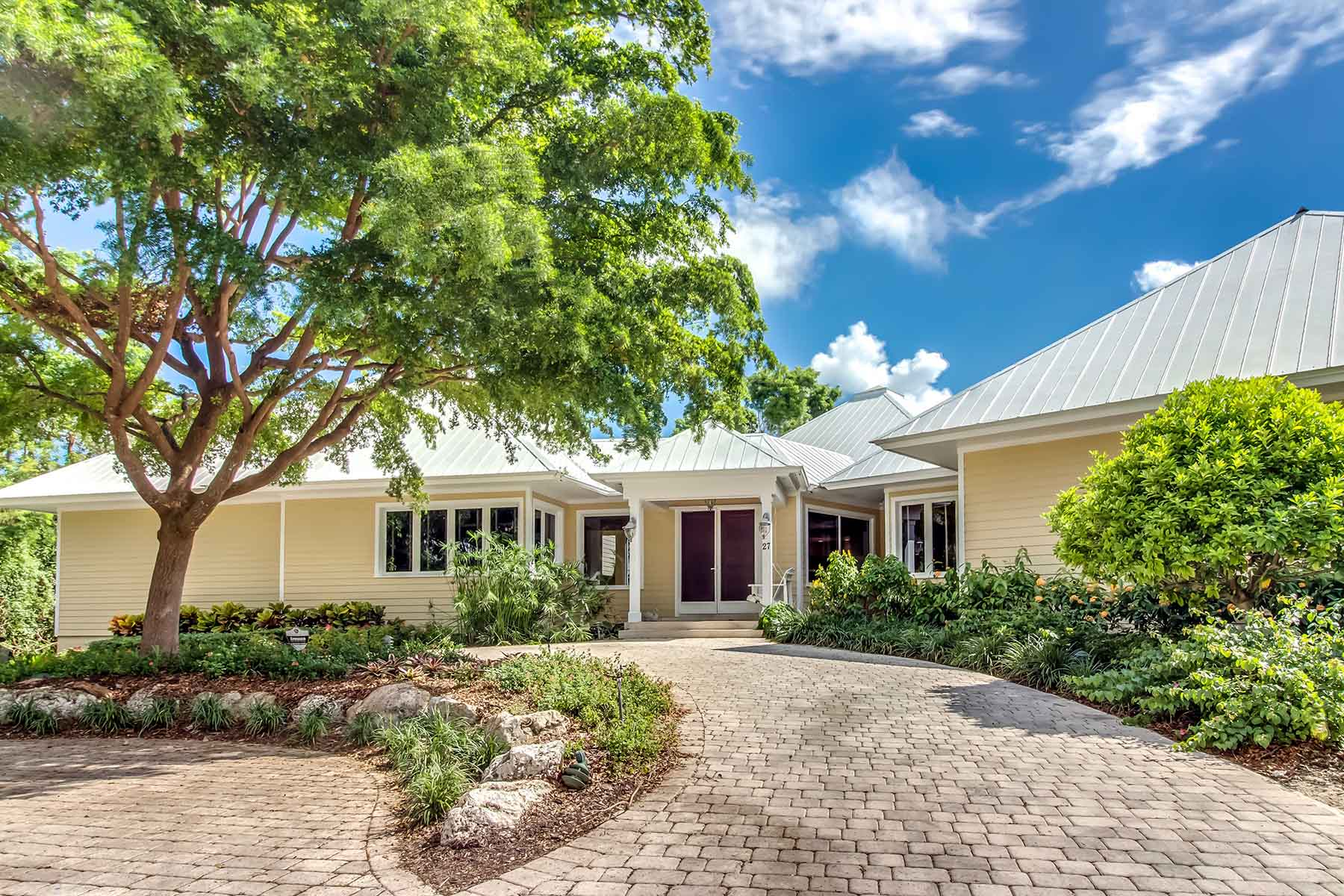 Single Family Home for Sale at Mesmerizing Hammock Course Home at Ocean Reef Club 27 Dilly Tree Park Key Largo, Florida 33037 United States