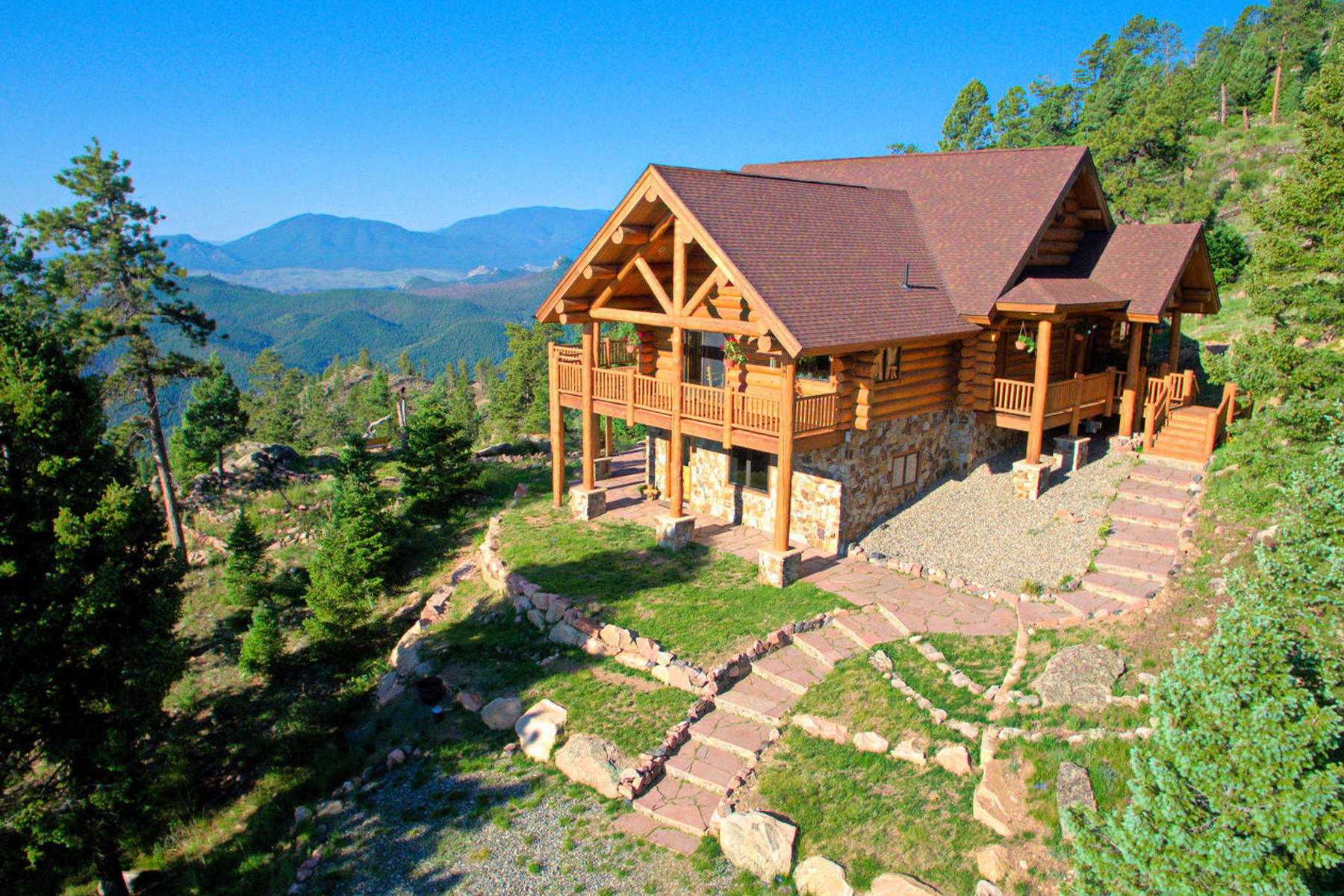 Single Family Home for Sale at Views are the Hallmark of this Full Round Log Constructed Home 13615 Pine Country Lane Conifer, Colorado, 80433 United States