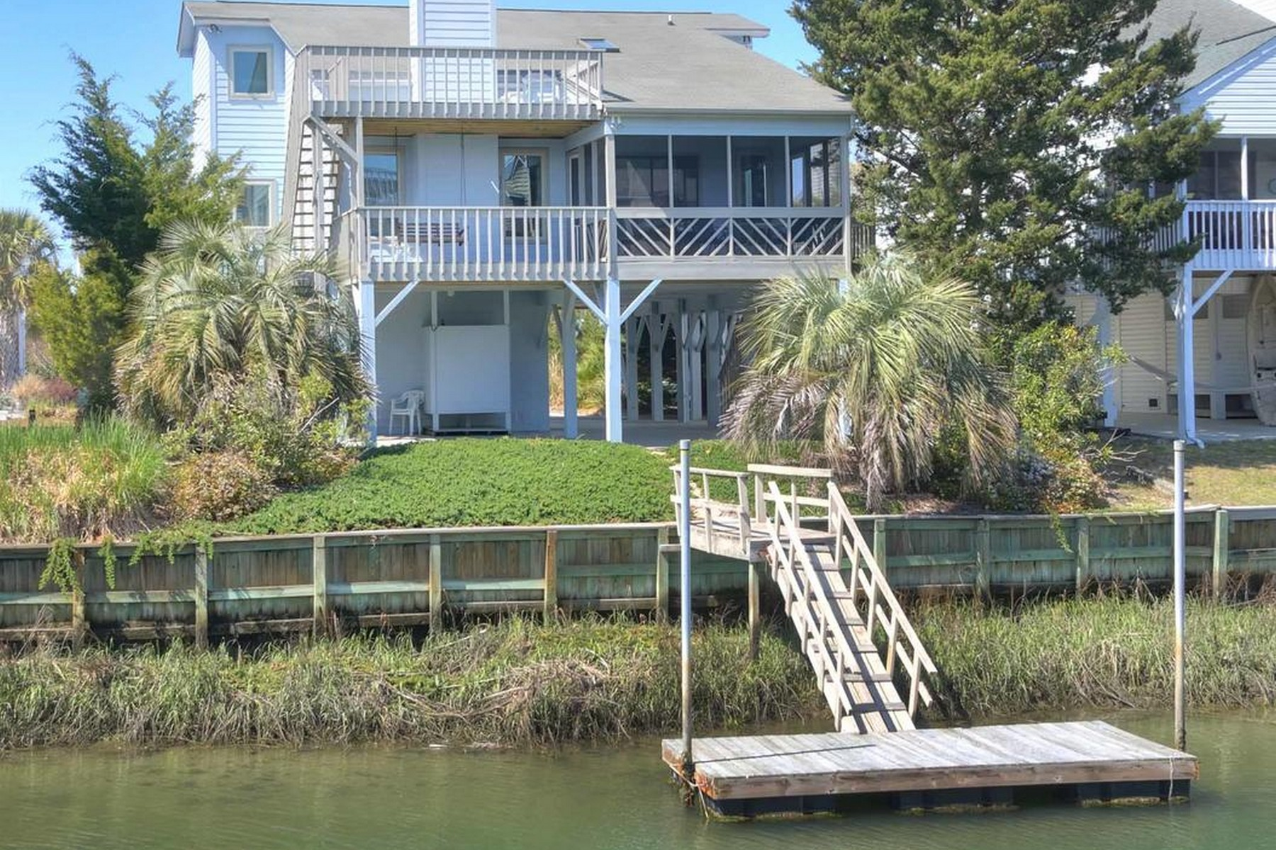 独户住宅 为 销售 在 Exceptional Island Home on the Canal 411 Sailfish Street Sunset Beach, 北卡罗来纳州, 28468 美国