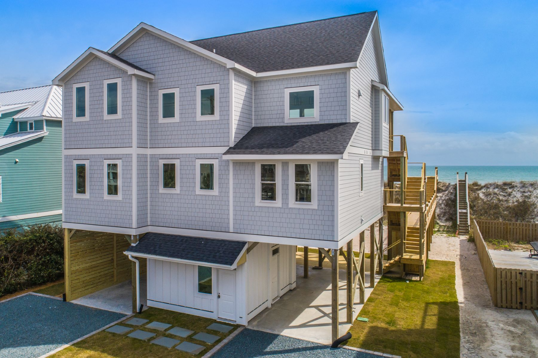 Single Family Homes for Sale at Extraordinary Oceanfront New Construction Home 3712 Island Drive N Topsail Beach, North Carolina 28460 United States