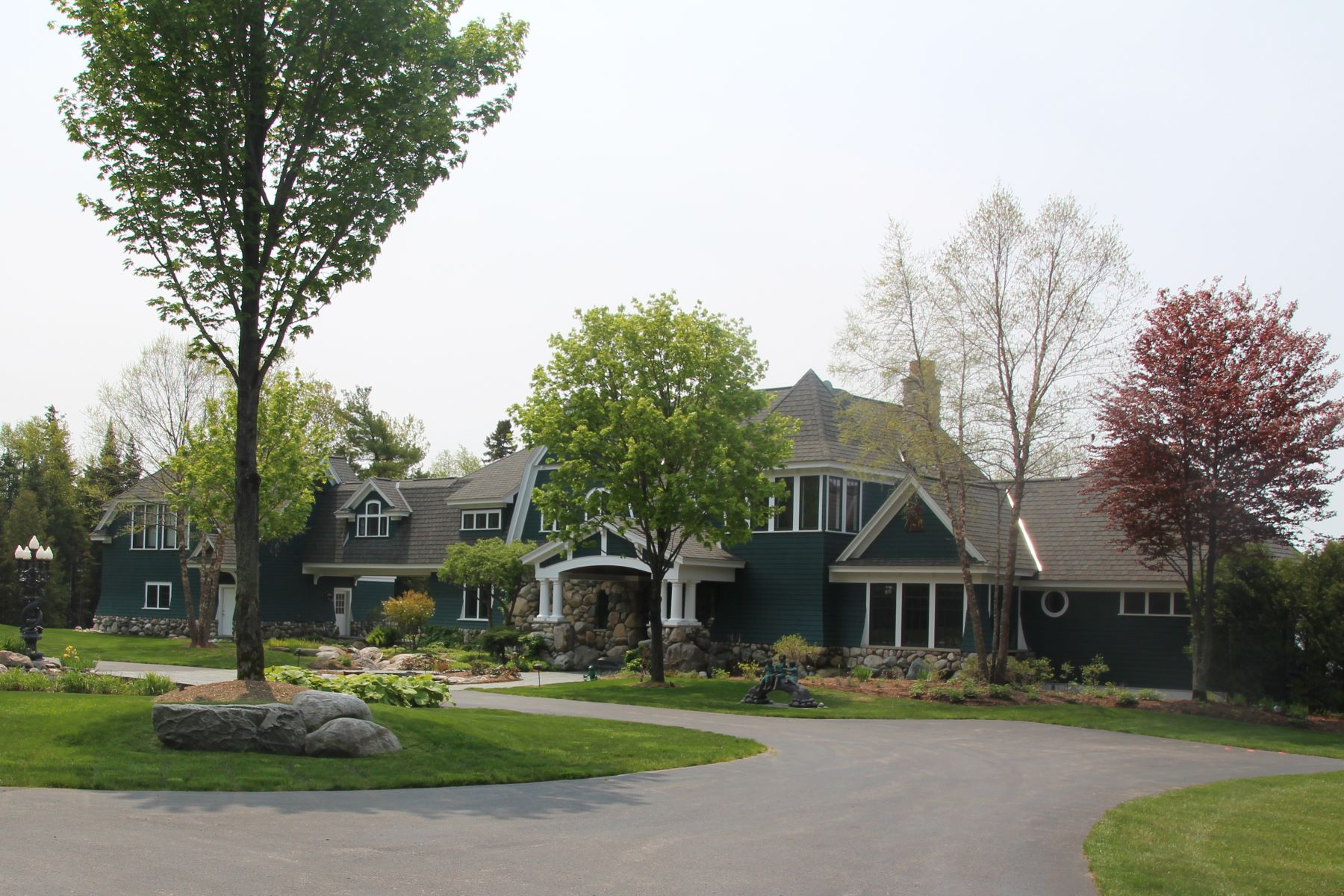 Single Family Homes for Active at Stunning location on Lake Charlevoix sits this custom built home 07575 Indian Trails Charlevoix, Michigan 49720 United States