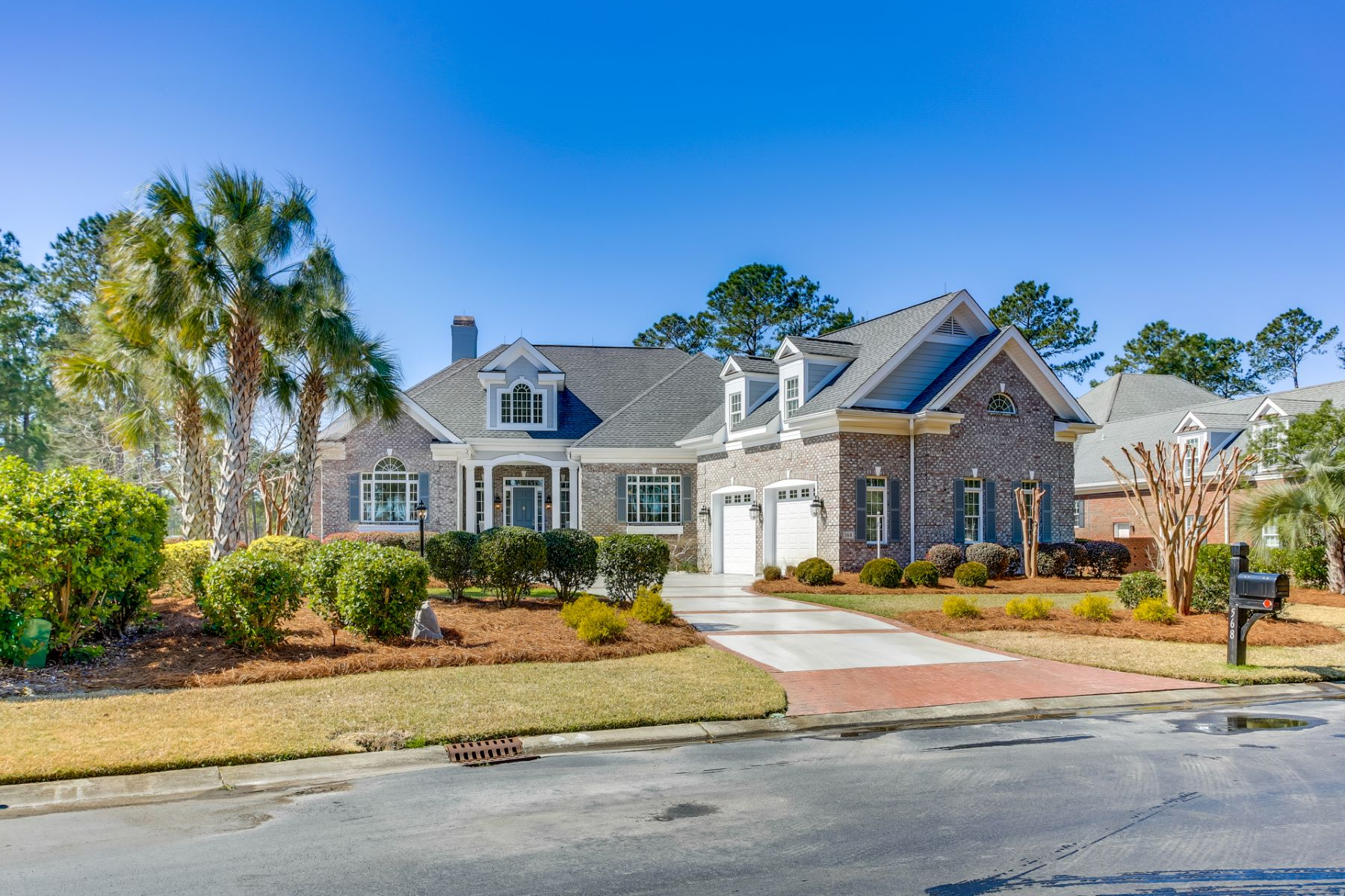 Single Family Homes for Active at Stunning Home Surrounded by Pristine Elegance 568 Wicklow Square SW Ocean Isle Beach, North Carolina 28469 United States