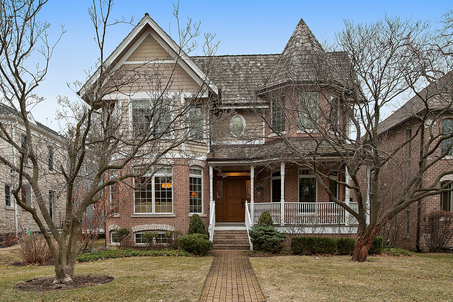 sales property at Stately Brick and Cedar Home