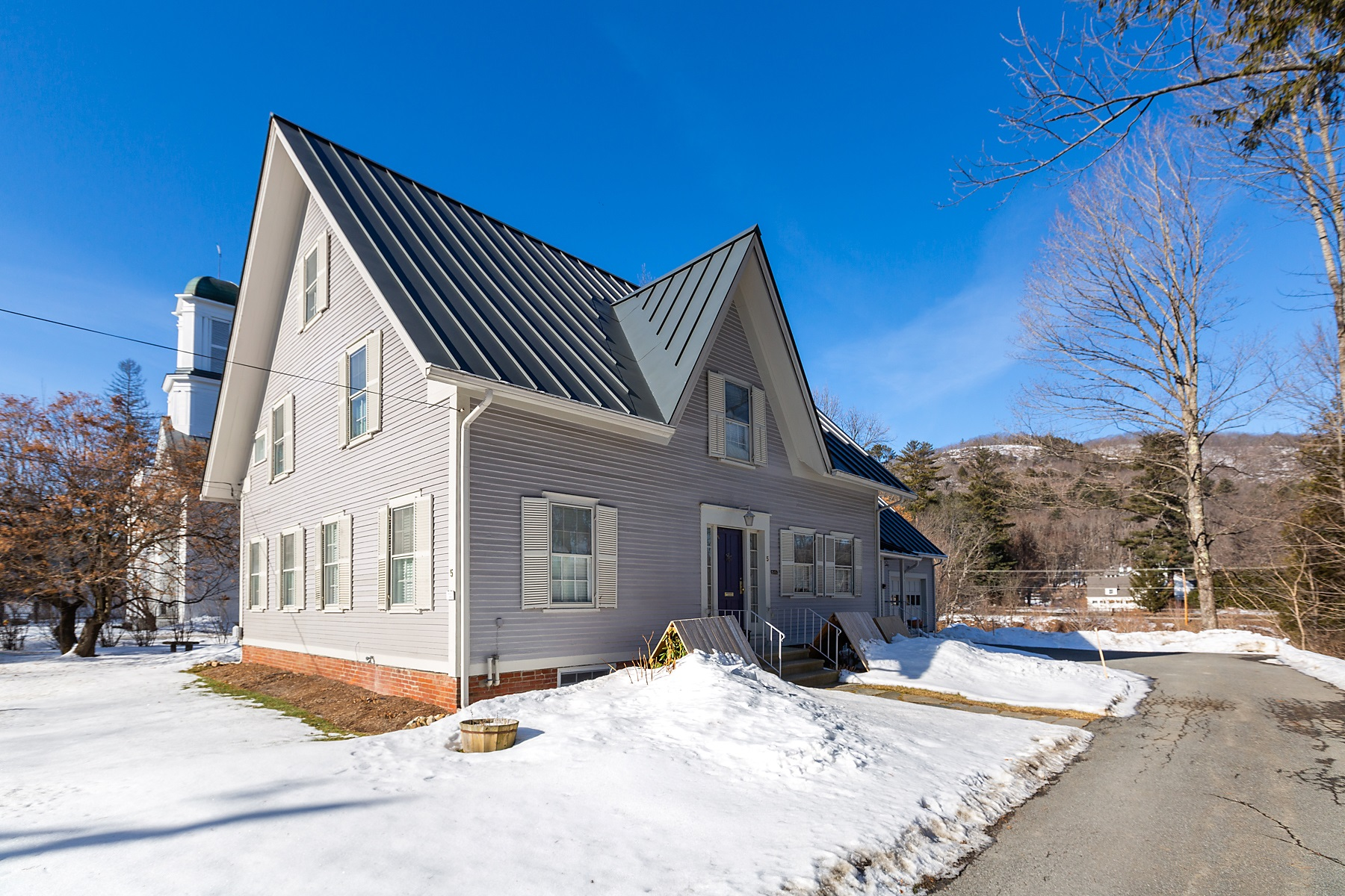 Single Family Homes for Sale at Extraordinary Riverfront Home 5 Church Street Woodstock, Vermont 05091 United States