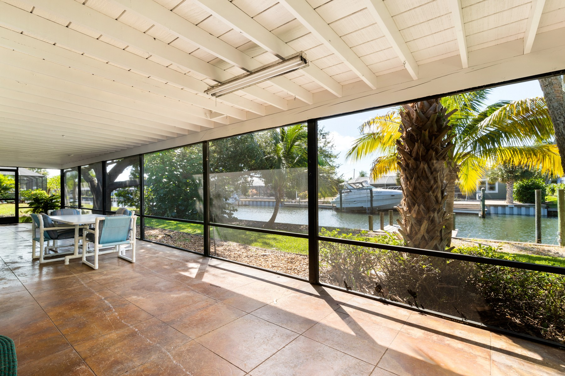 Additional photo for property listing at Charming Canal Front Home with Airy, Open Layout 393 Nikomas Way Melbourne Beach, Florida 32951 United States