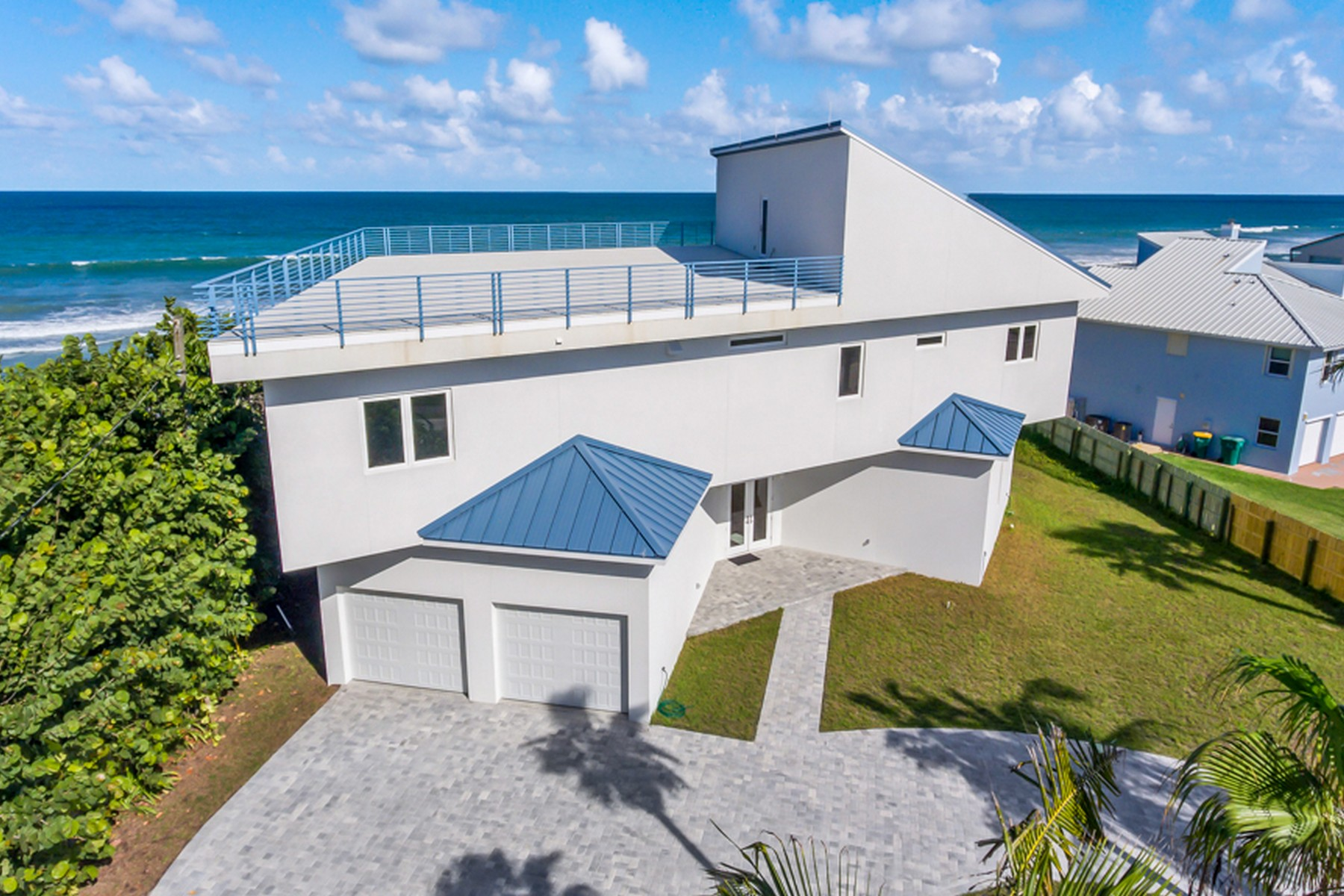 Single Family Home for Sale at Contemporary Oceanfront Home 5285 S. Highway A1A Melbourne Beach, Florida 32951 United States