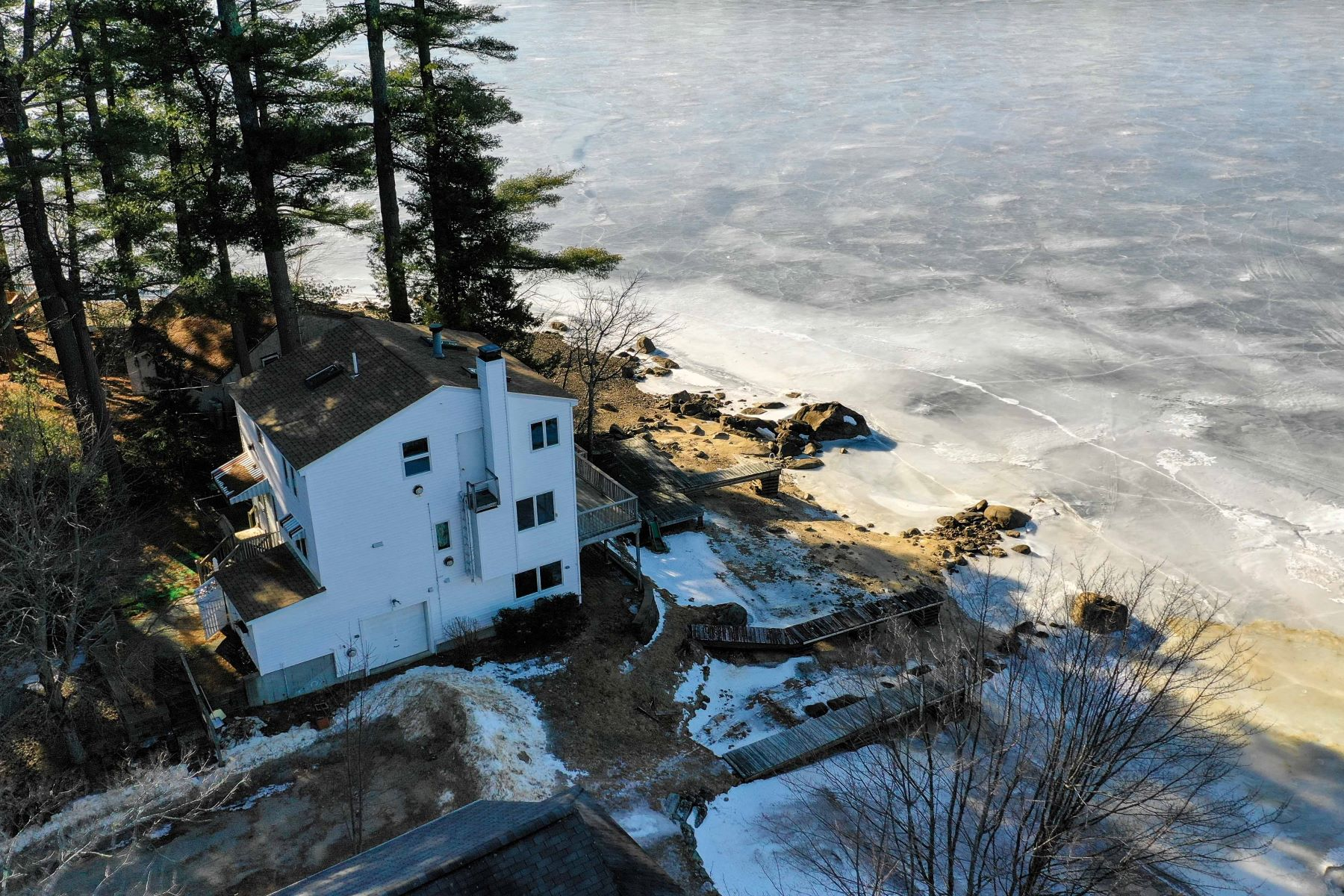 Single Family Home for Sale at Lakefront Living with Sunset Views 42 White Grove Road Nottingham, New Hampshire 03290 United States