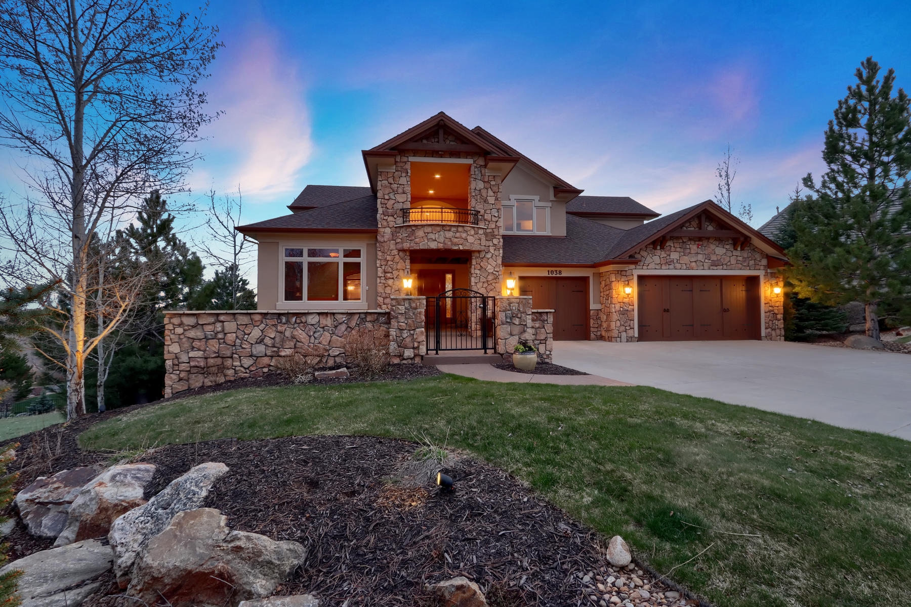 Single Family Homes for Sale at This spectacular custom home is located on a large cul-de-sac 1038 Buffalo Ridge Way, Castle Pines, Colorado 80108 United States