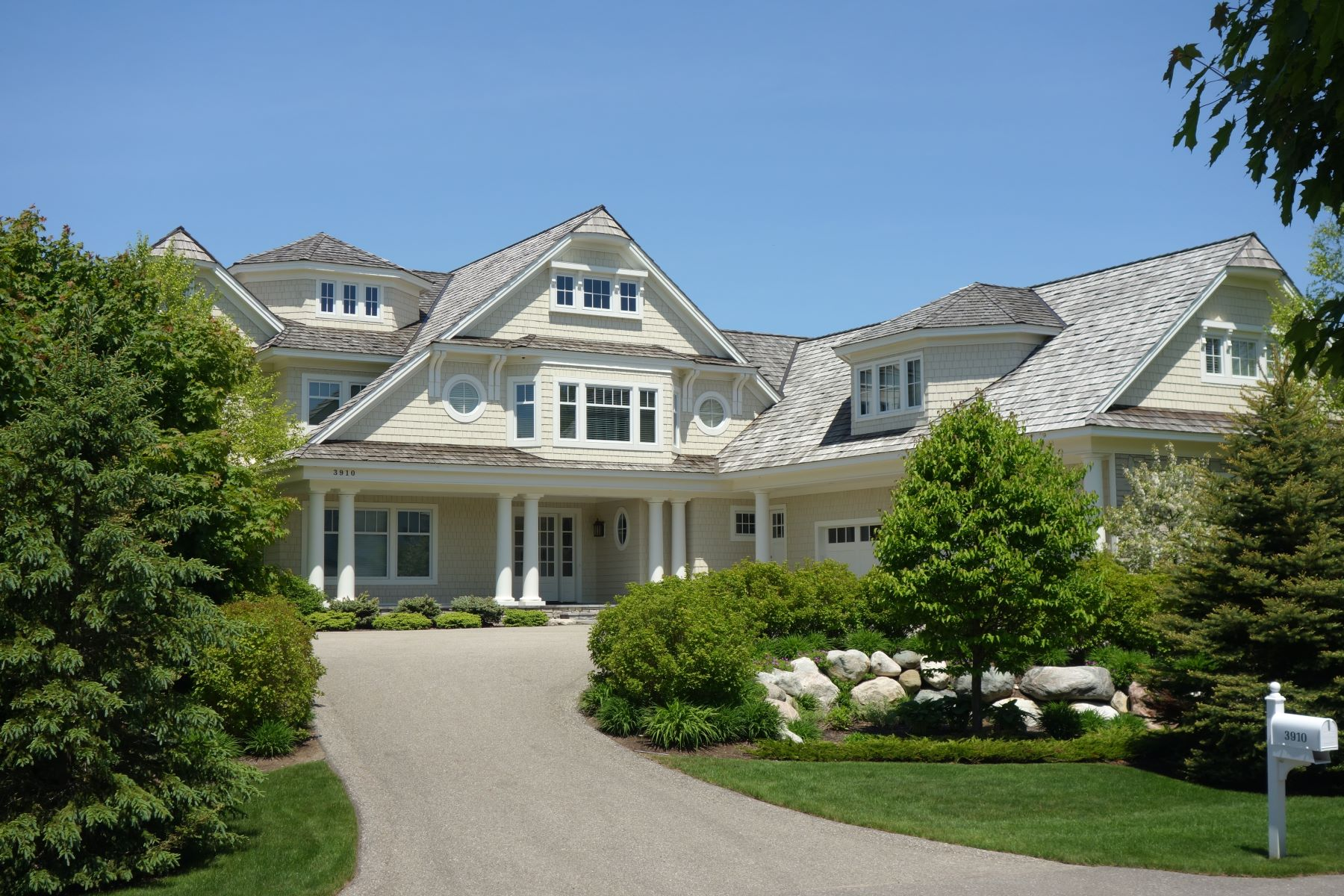 Single Family Homes for Sale at Grand and Inviting Waterfront Home 3910 Peninsula Drive Bay Harbor, Michigan 49770 United States