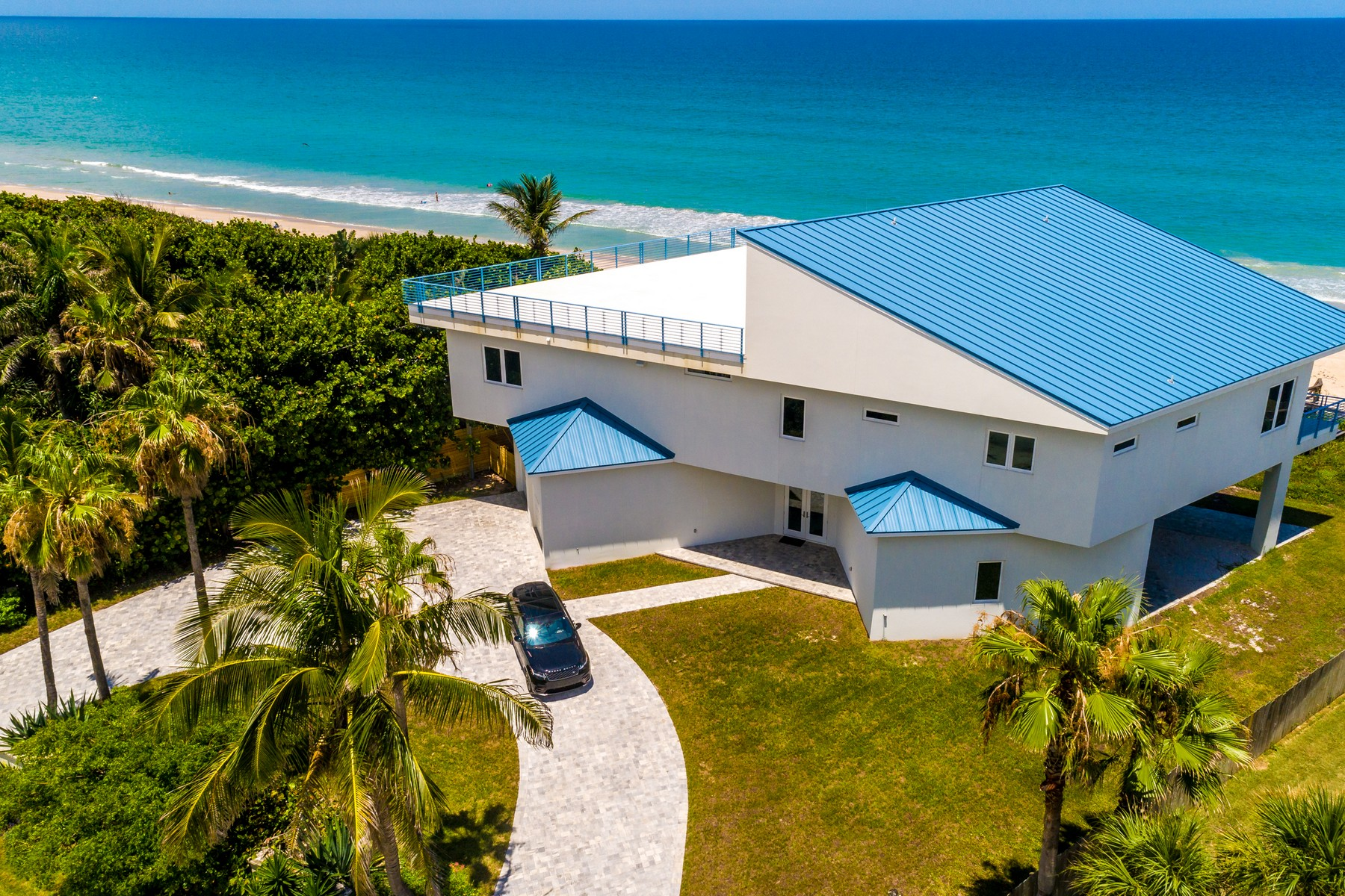 Single Family Homes for Sale at Contemporary Oceanfront Home 5285 S. Highway A1A Melbourne Beach, Florida 32951 United States
