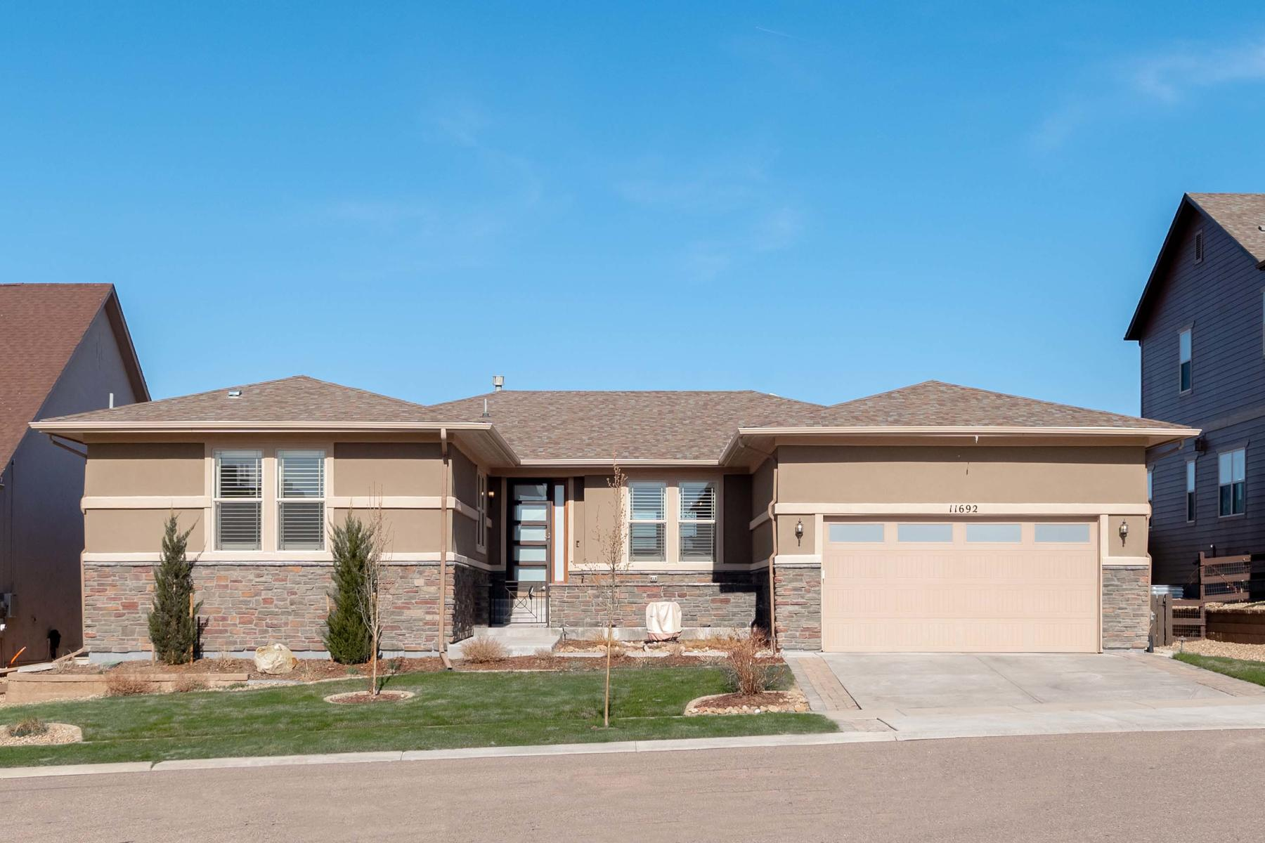 Single Family Homes for Sale at An absolute showstopper in Heirloom! Full of natural light with a show home feel 11692 Spotted Street Parker, Colorado 80134 United States