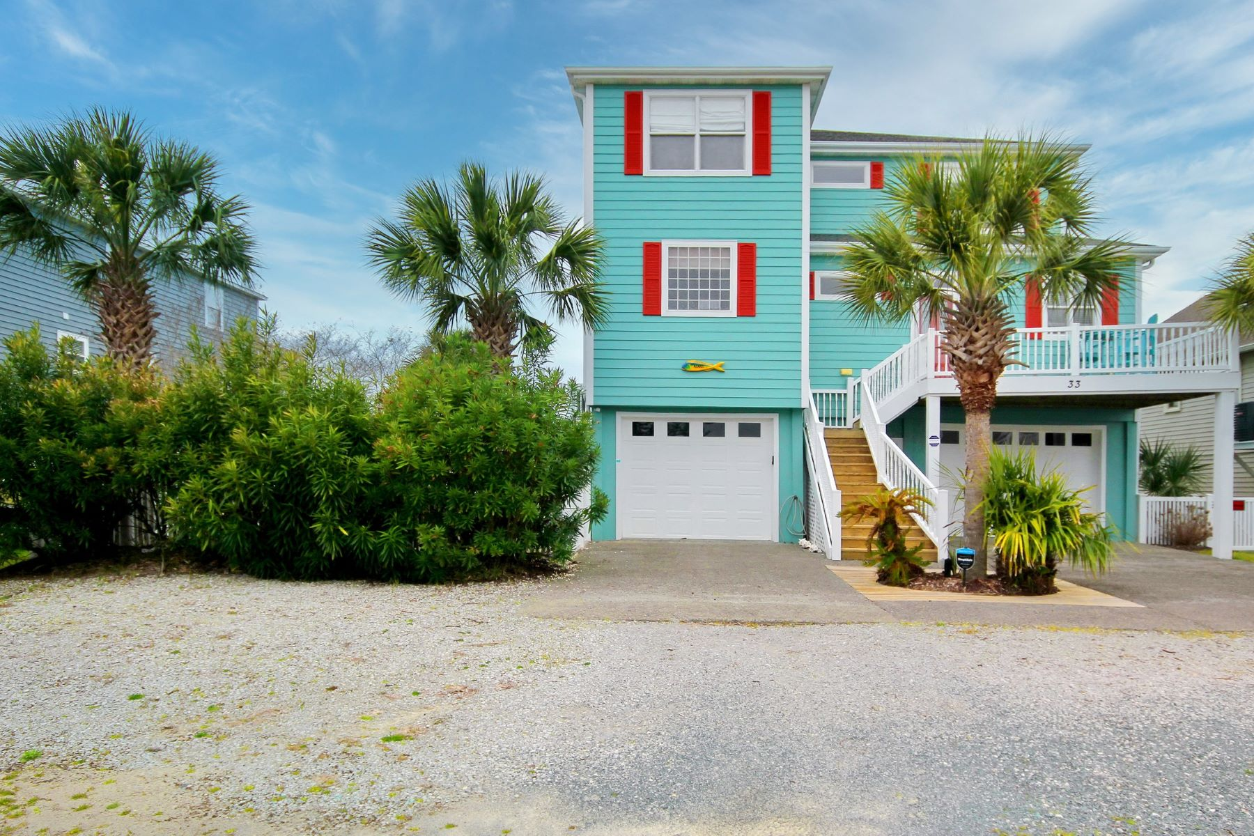 Single Family Homes for Sale at The Perfect Oasis Surrounded by Water 33 Wilmington Street Ocean Isle Beach, North Carolina 28469 United States