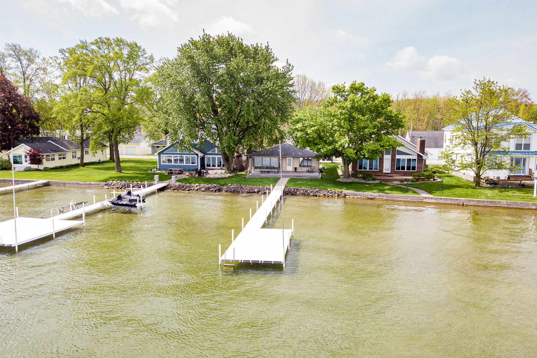 single family homes for Active at Lake Wawasee with Private Boathouse 8256 E Highland View Drive Syracuse, Indiana 46567 United States