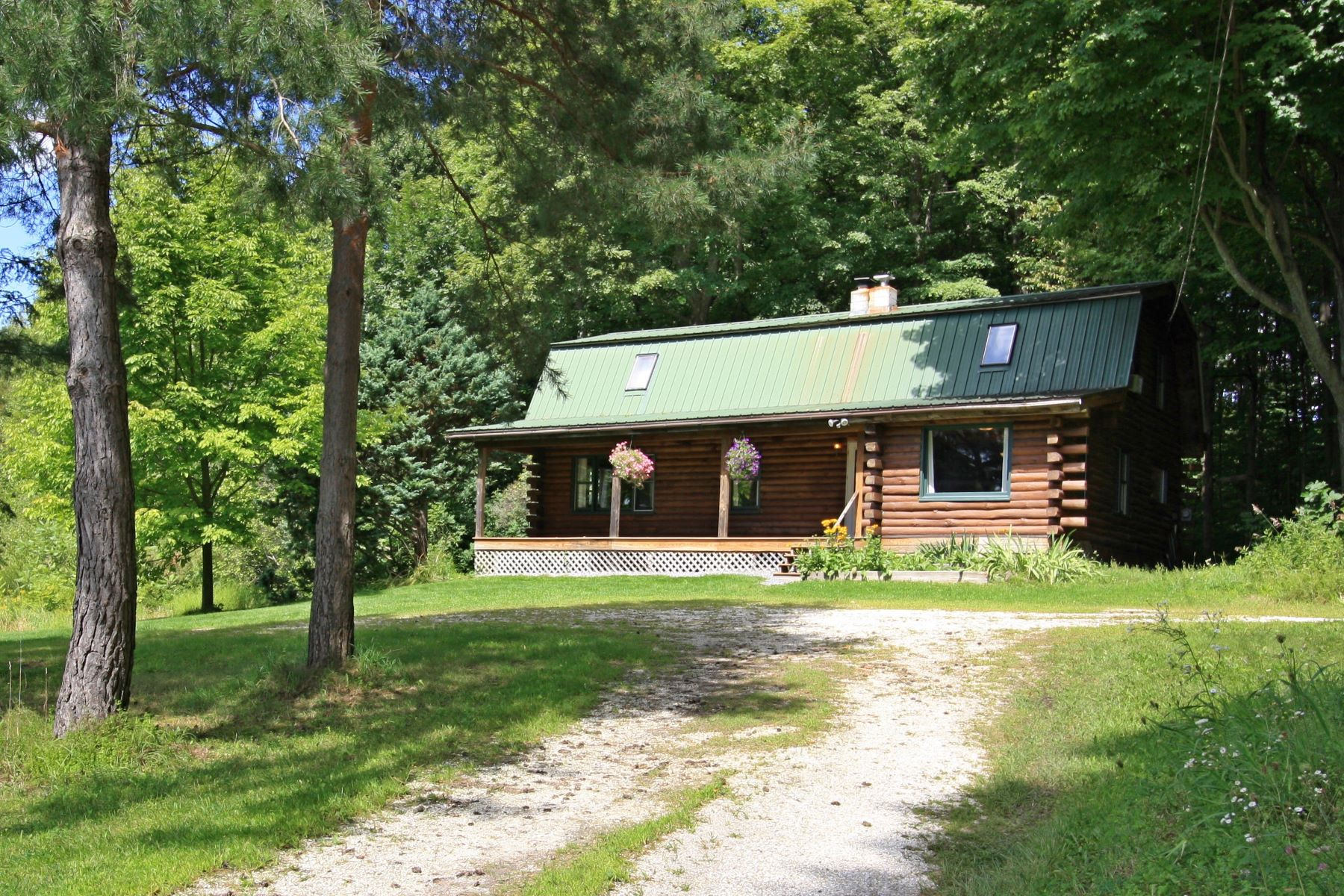 Single Family Homes for Sale at A home for all seasons 608 Perkins Rd Weybridge, Vermont 05753 United States