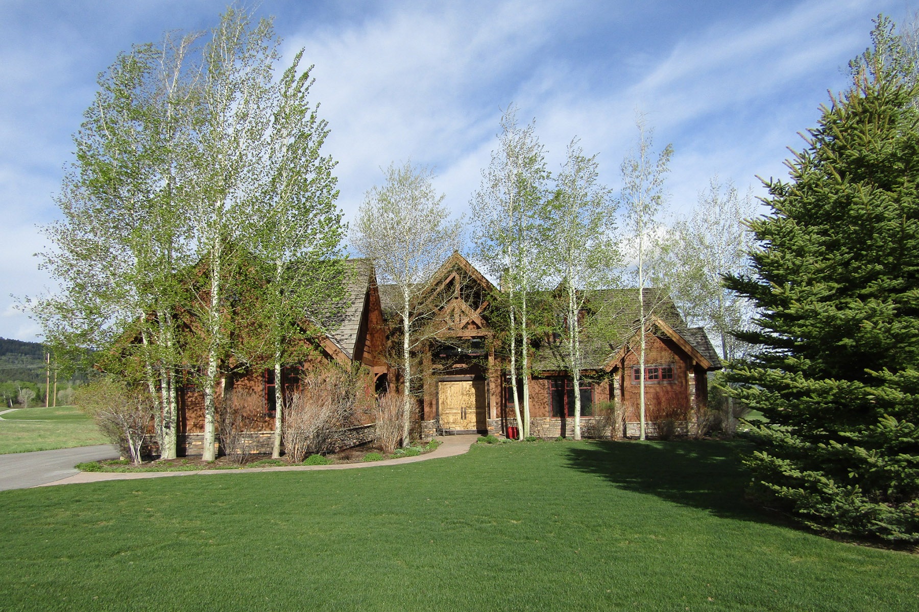 Single Family Homes for Active at Teton Springs Elegance on the 7th Hole 8 Winger Cir Victor, Idaho 83455 United States