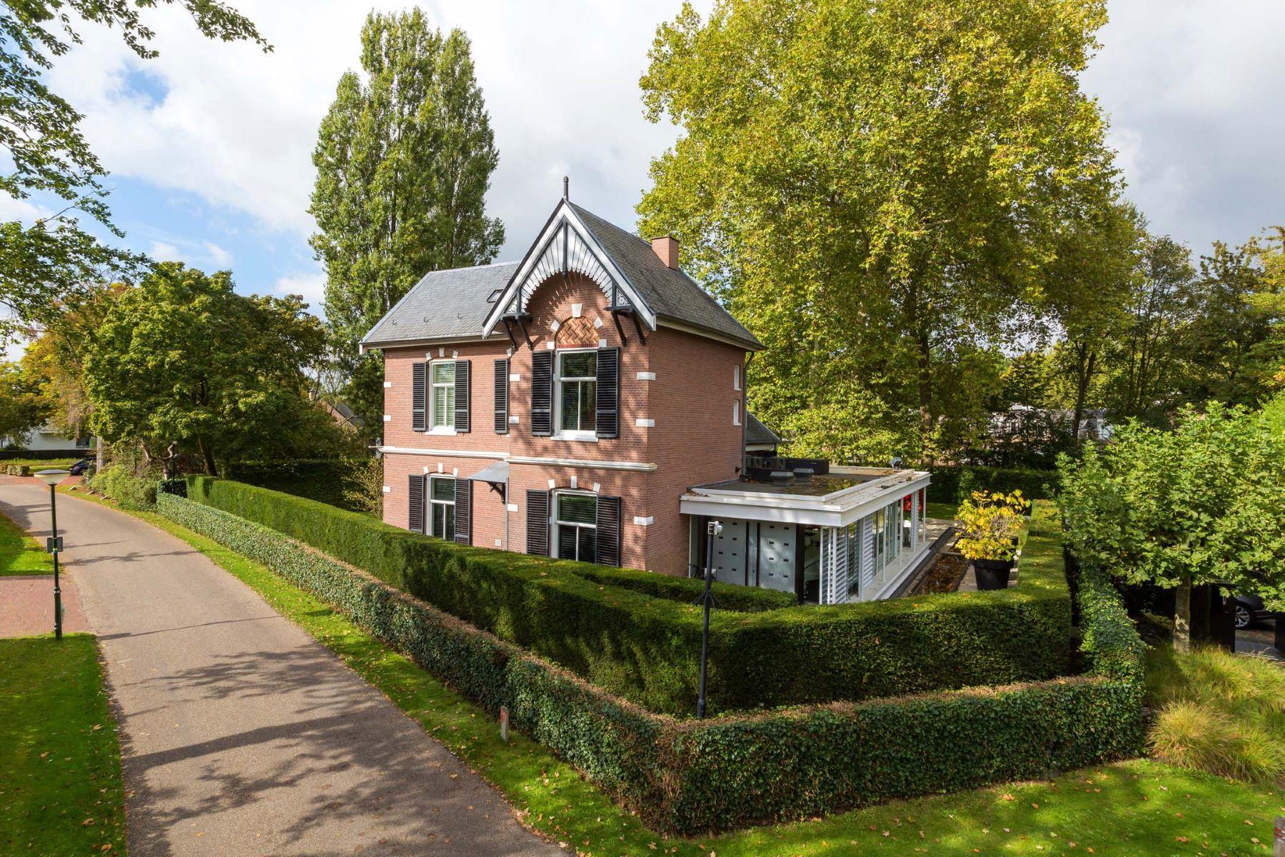 Single Family Homes for Sale at Authentic, modern villa in splendid green village Nuenen, North Brabant Netherlands