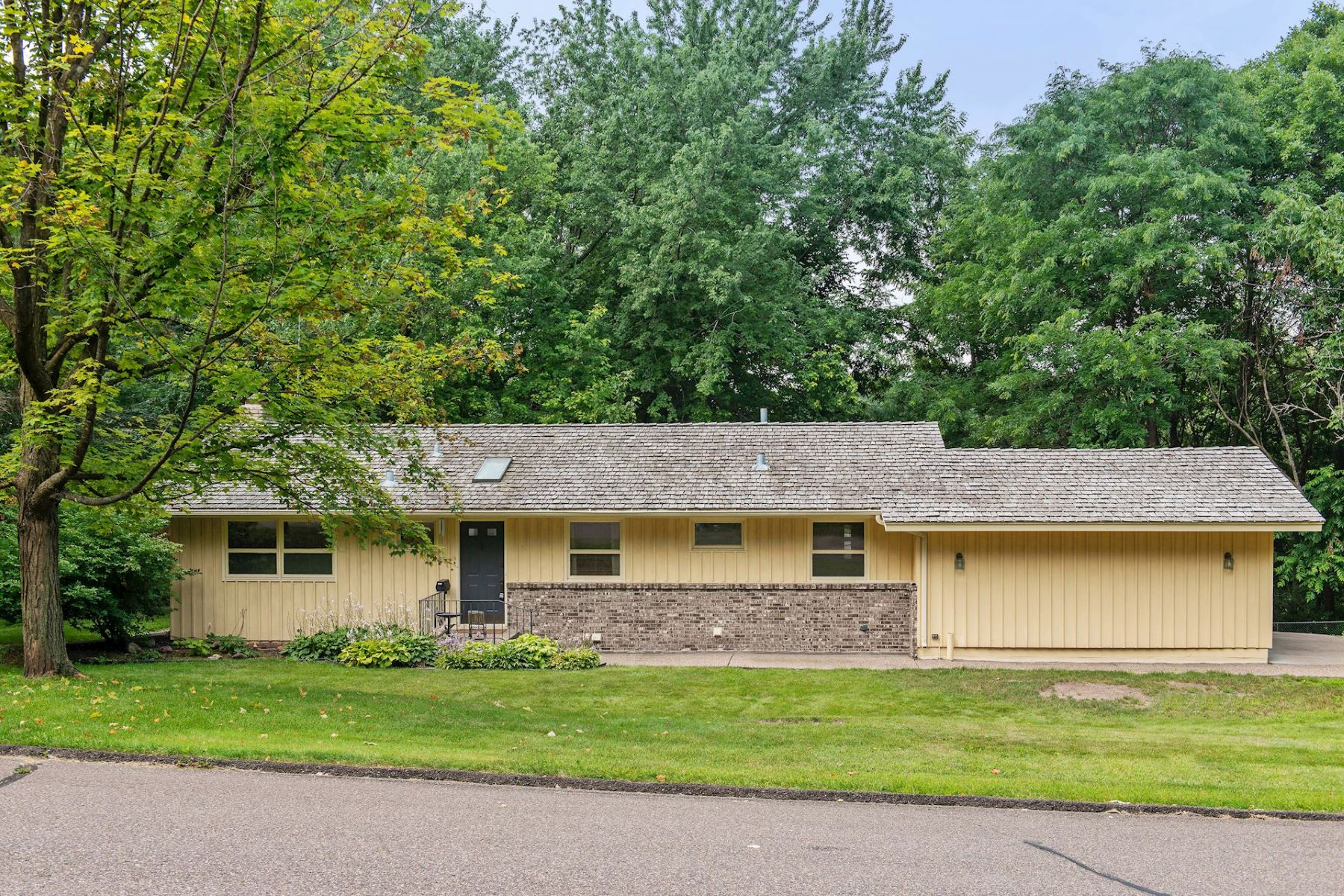 Single Family Homes للـ Sale في Well Maintained Rambler with Original Retro Finishes that Remain Popular Today! 5036 Woodgate Court, Minnetonka, Minnesota 55345 United States