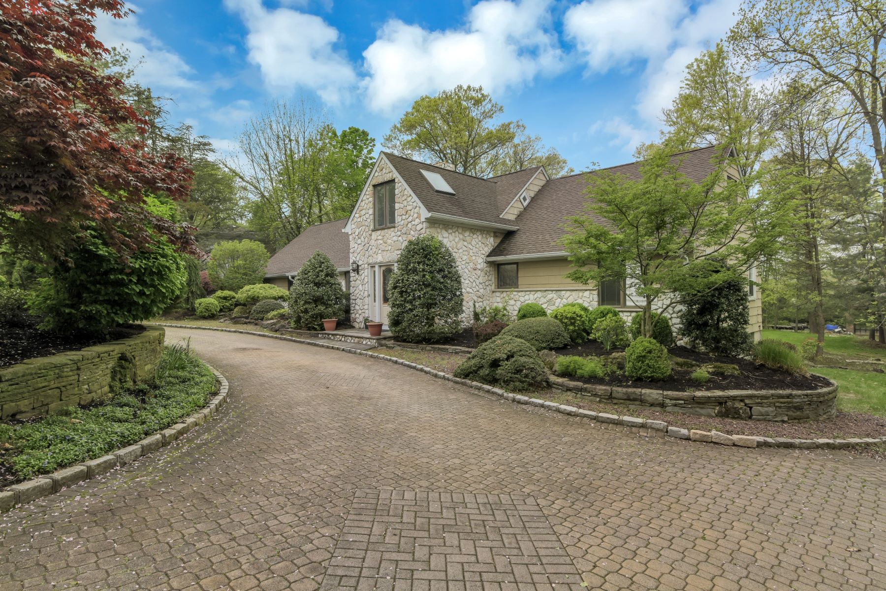Single Family Homes for Sale at Stately Stone Front Expanded Ranch 141 Summit Road Florham Park, New Jersey 07932 United States
