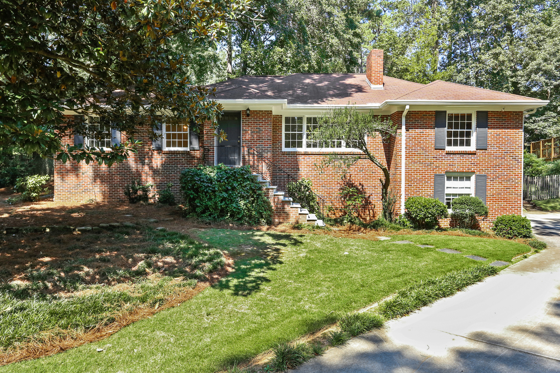 Single Family Home for Sale at Charming Brick Ranch On A Large Lot With Incredible Backyard 388 Lakemoore Drive Atlanta, Georgia 30342 United States