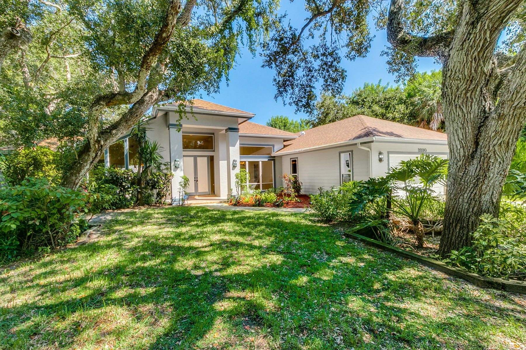 Single Family Homes for Sale at Beachside Home on Over One Half Acre! 3390 Mariners Way Vero Beach, Florida 32963 United States