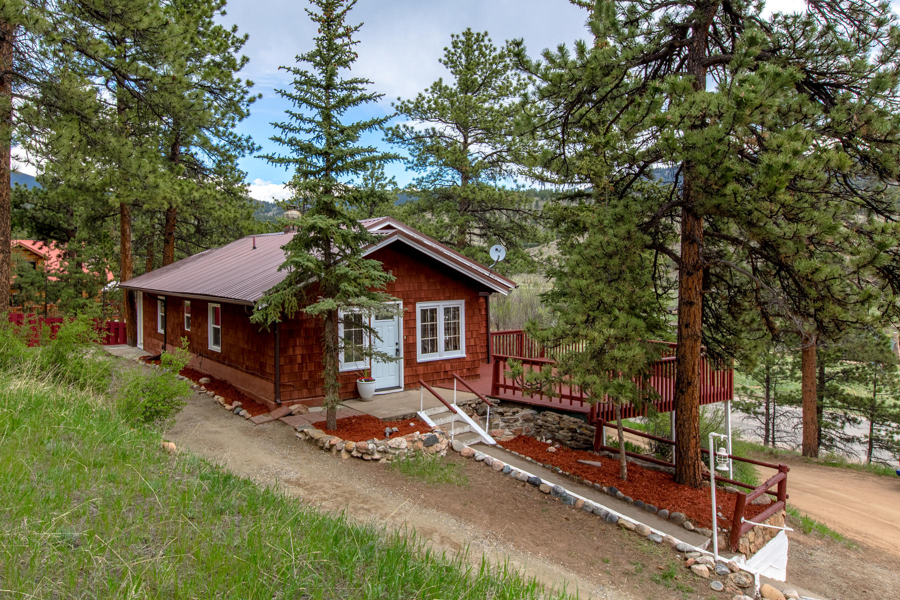 Single Family Homes for Sale at Charming Mountain Cabin with Views Overlooking the North Platte River Valley 31 West Shawnee Road, Shawnee, Colorado 80475 United States