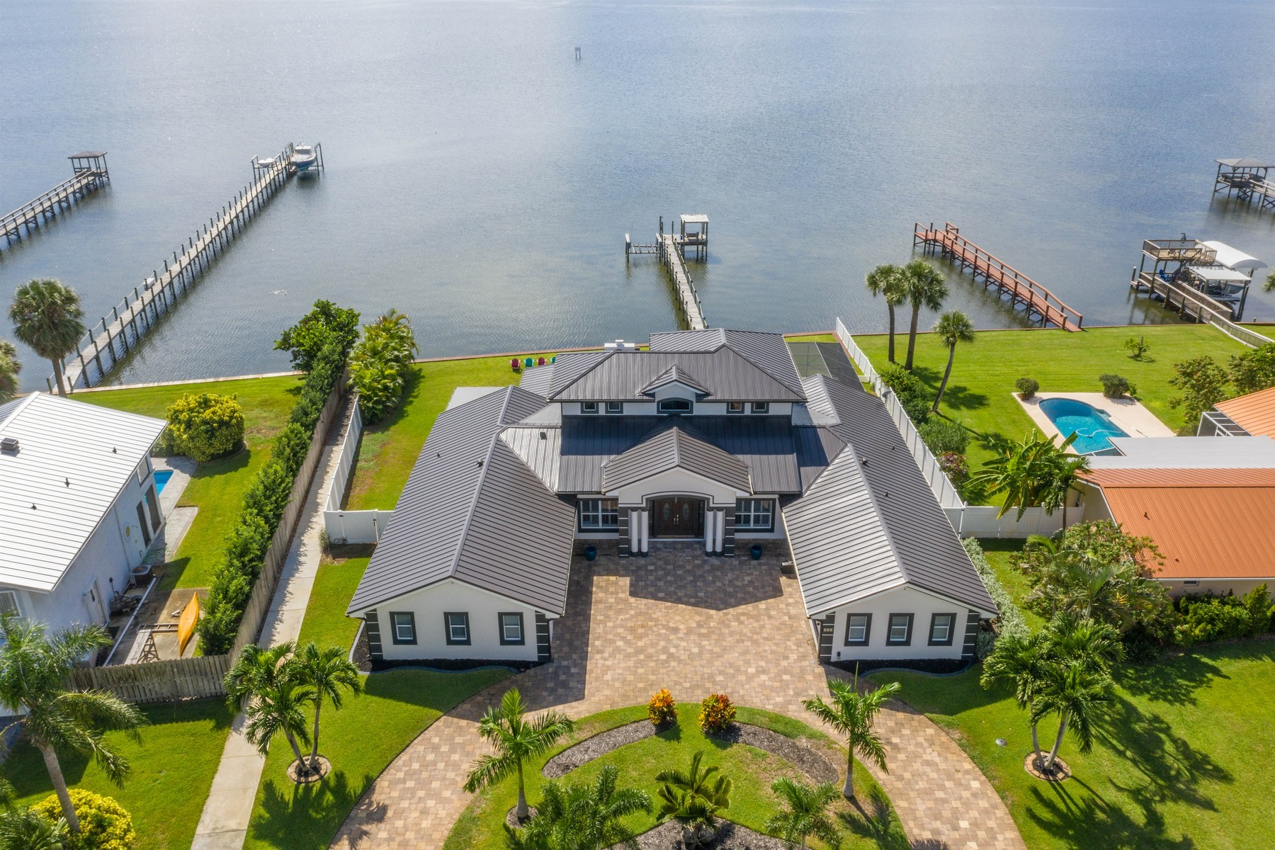 Single Family Home for Sale at Wonderful Riverfront Pool Home in Quiet Neighborhood 235 Sea Crest Drive Melbourne Beach, Florida 32951 United States