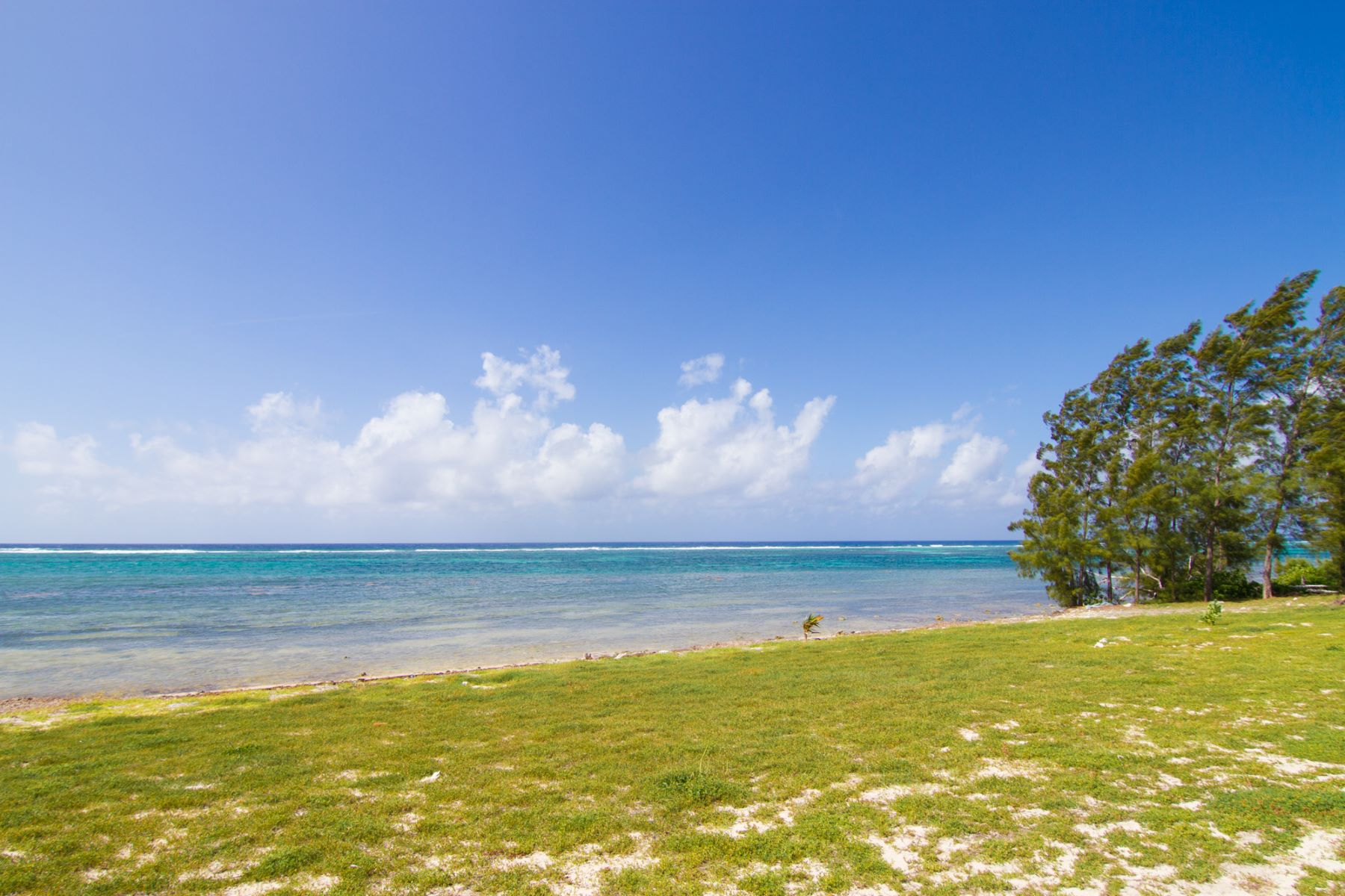 Additional photo for property listing at Tequila Sunrise at Paradise Villas Vacation Rental East End,  Cayman Islands