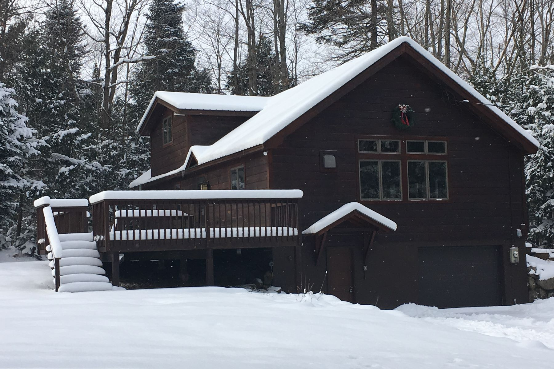 Single Family Home for Sale at Meticulously maintained family home in a private setting 436 State Route 28 Inlet, New York 13420 United States