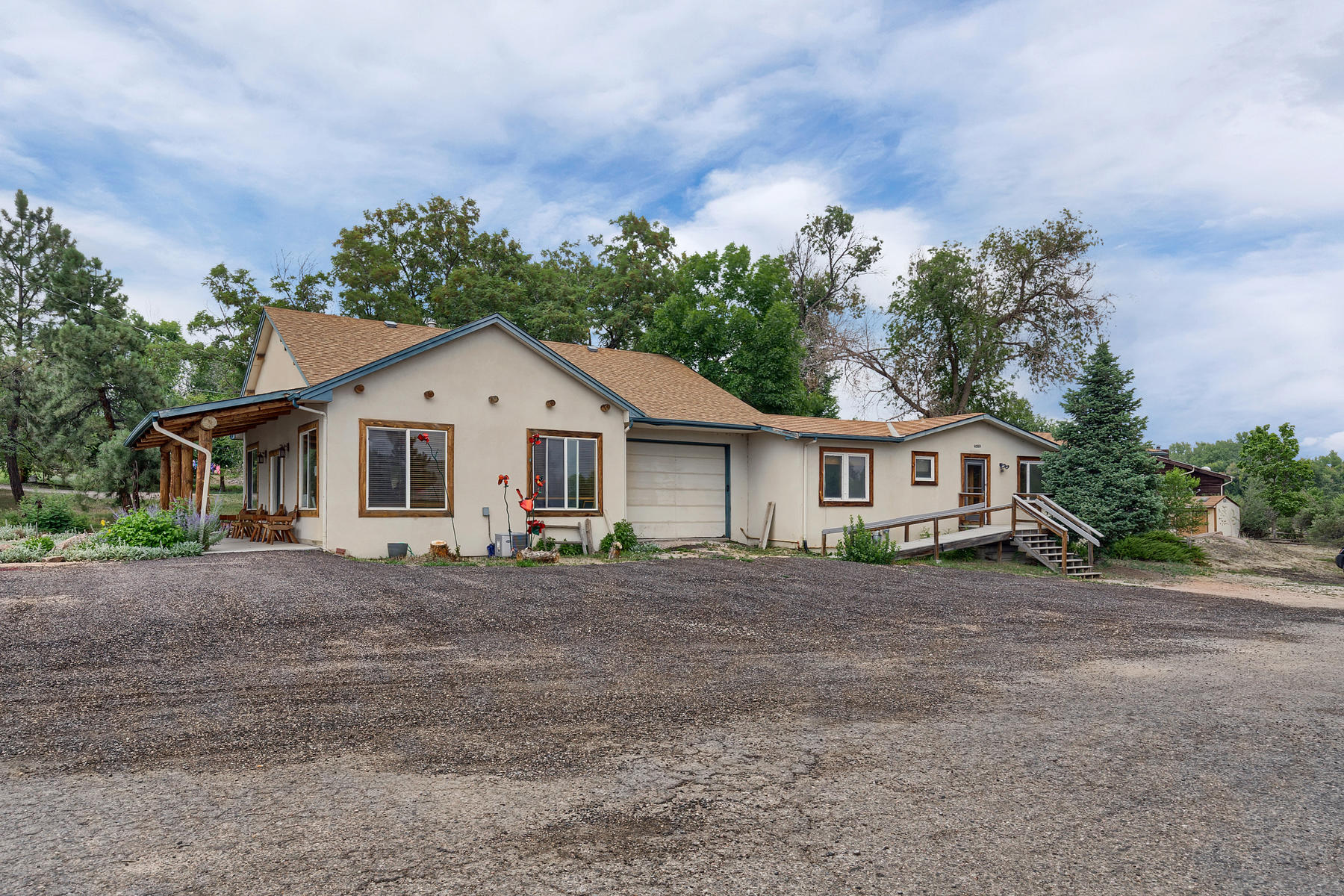 Single Family Home for Active at Rare opportunity to live & office in quiet, downtown Sedalia. 5406 N State Highway 67 Sedalia, Colorado 80135 United States
