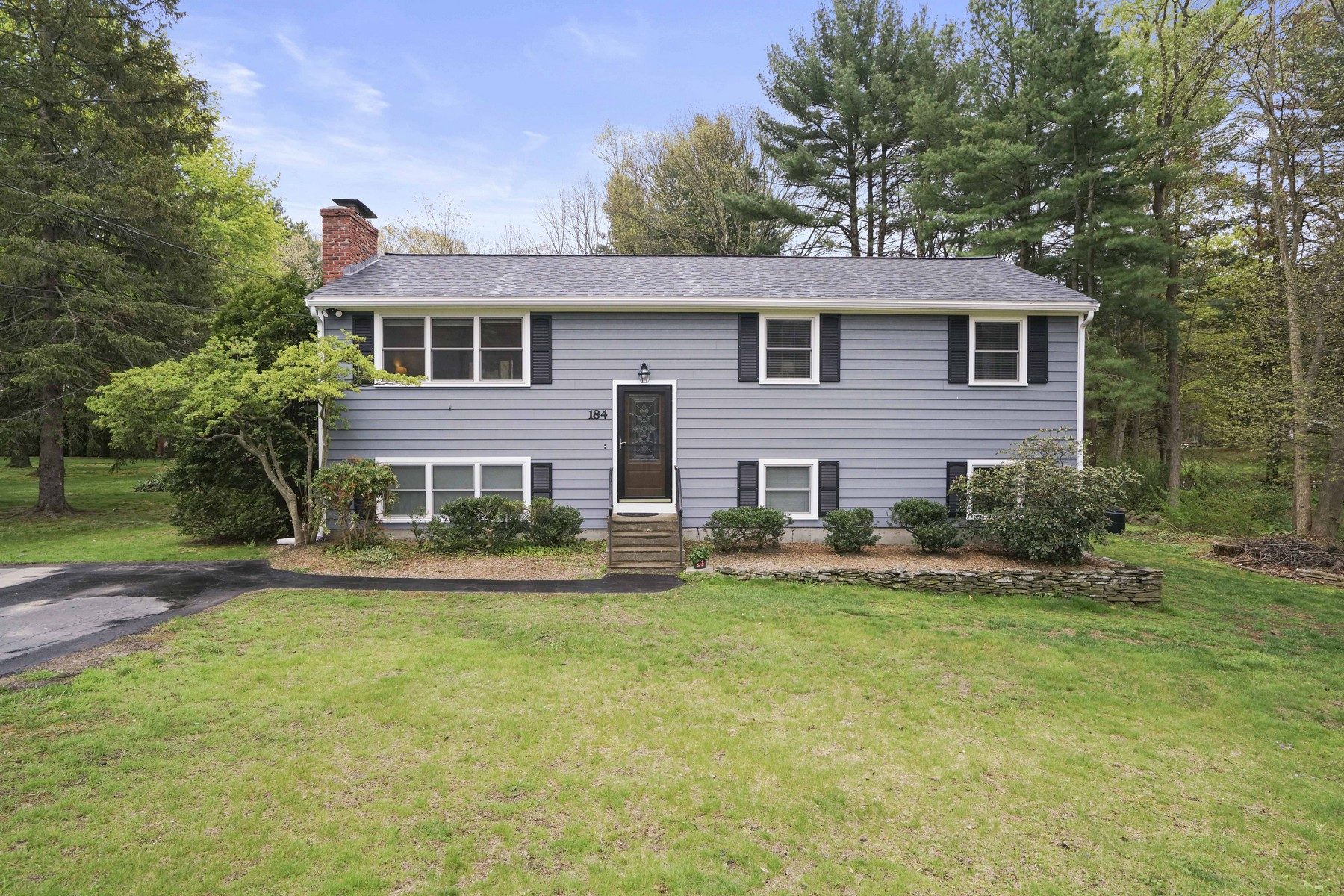 Single Family Homes for Active at Charming Split Level Home 184 Woodland Road Southborough, Massachusetts 01772 United States