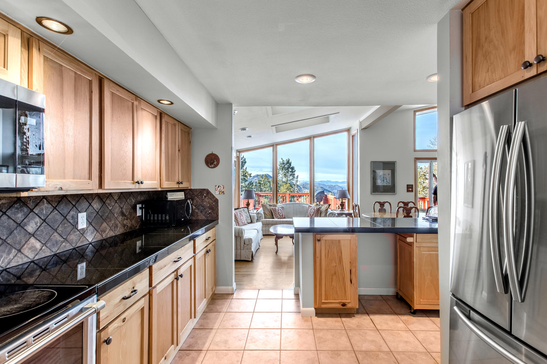 Single Family Homes for Sale at Charming Mountain Home with Long Distance City Views. 19941 Maxwell Drive Morrison, Colorado 80465 United States