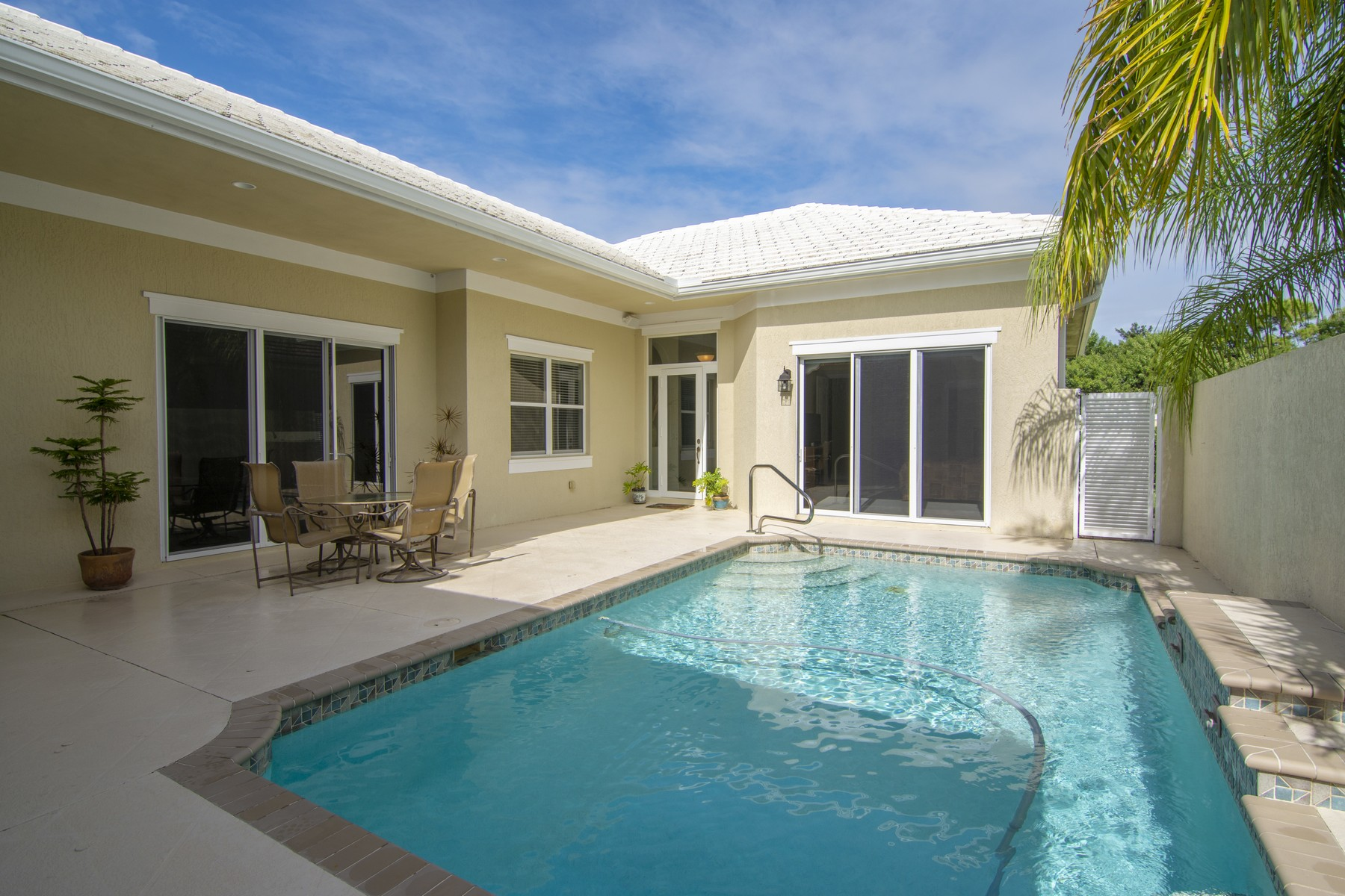 Single Family Homes for Sale at Generous Courtyard-Style Pool Home with Stylish Details 1025 Riverwind Circle Vero Beach, Florida 32967 United States