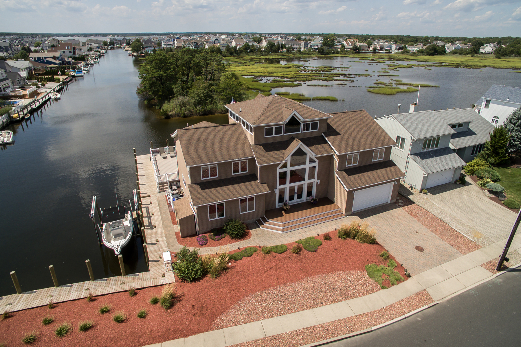Single Family Homes for Sale at Custom Designed Waterfront Contemporary Style Home 98 Cedar Island Drive Brick, New Jersey 08723 United States