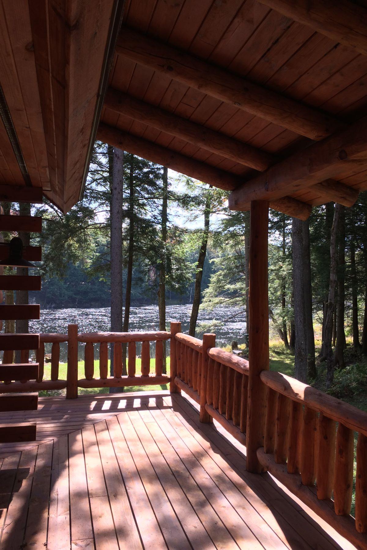 Maison unifamiliale pour l Vente à Personal Sanctuary with Cedar Log Home and Private Lake 162 Farr Rd. Remsen, New York 13438 États-Unis
