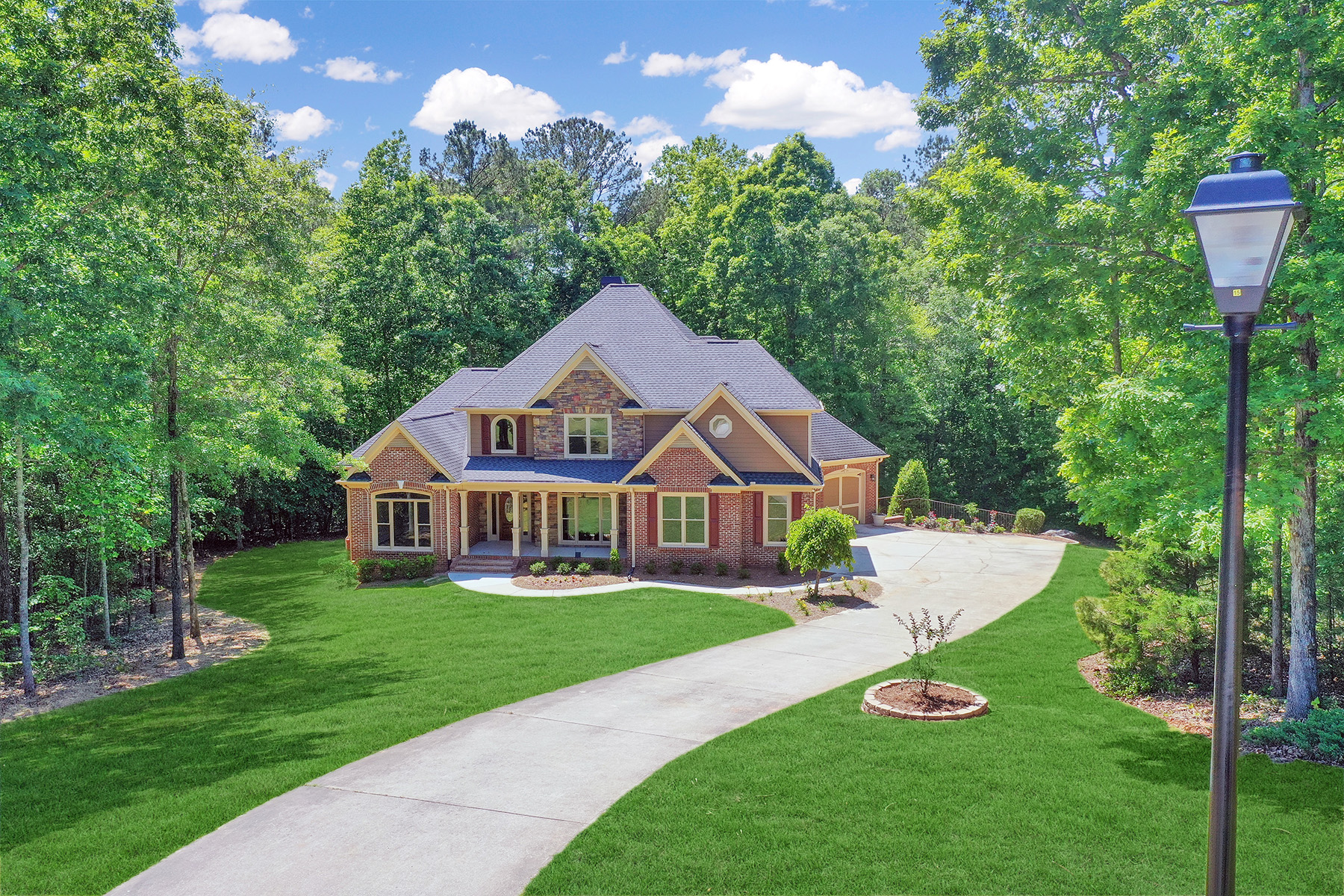 Single Family Homes for Sale at Beautiful Longview Creekside Home 130 Oak Forest Drive Oxford, Georgia 30054 United States
