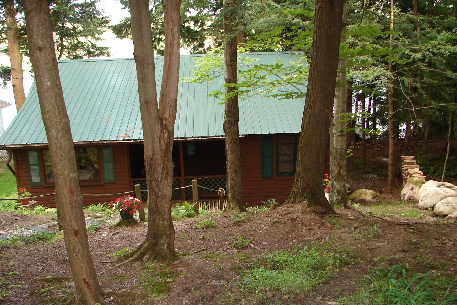 Additional photo for property listing at Rustic seasonal camp with 60 feet of waterfront on serene Otter Lake 4251 Lakeview Rd Forestport, Nueva York 13494 Estados Unidos