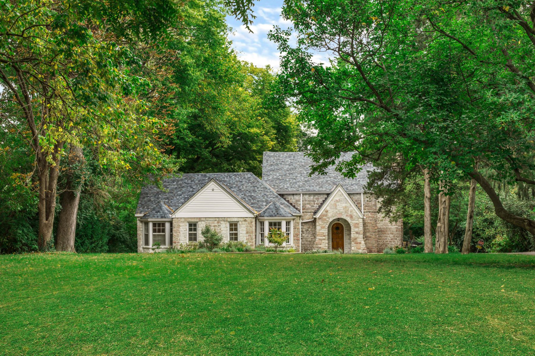 Single Family Homes for Sale at Beautiful Stone House in Ladue 9117 Clayton Road Ladue, Missouri 63124 United States