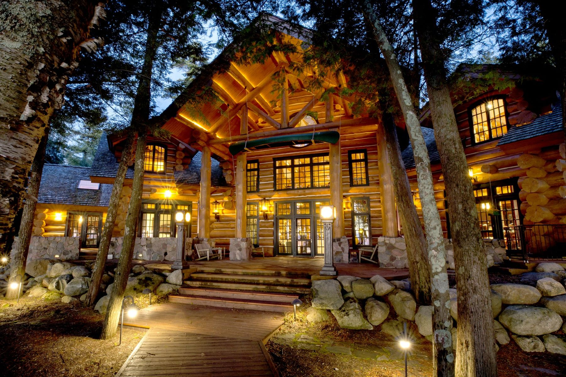 Single Family Homes for Active at Stunning Lake Michigan Waterfront Log Home in Charlevoix, Michigan 11721 N. Pa Be Shan Trail Charlevoix, Michigan 49720 United States
