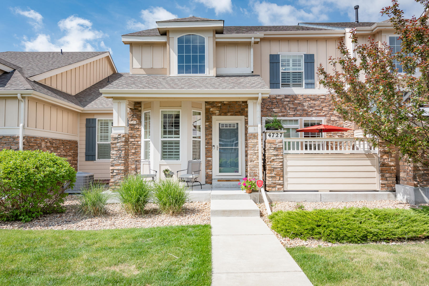 Single Family Homes for Sale at Immaculate, Spacious Townhome in Broomfield's Wildgrass 4727 Raven Run Broomfield, Colorado 80023 United States
