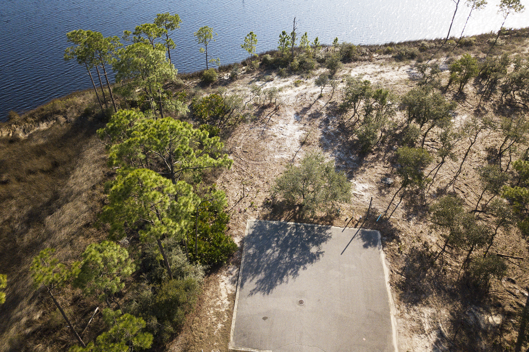 Terreno para Venda às Spacious Homesite With Over 200' of Lake Frontage 1101 E Water Oak Panama City Beach, Florida 32413 Estados Unidos
