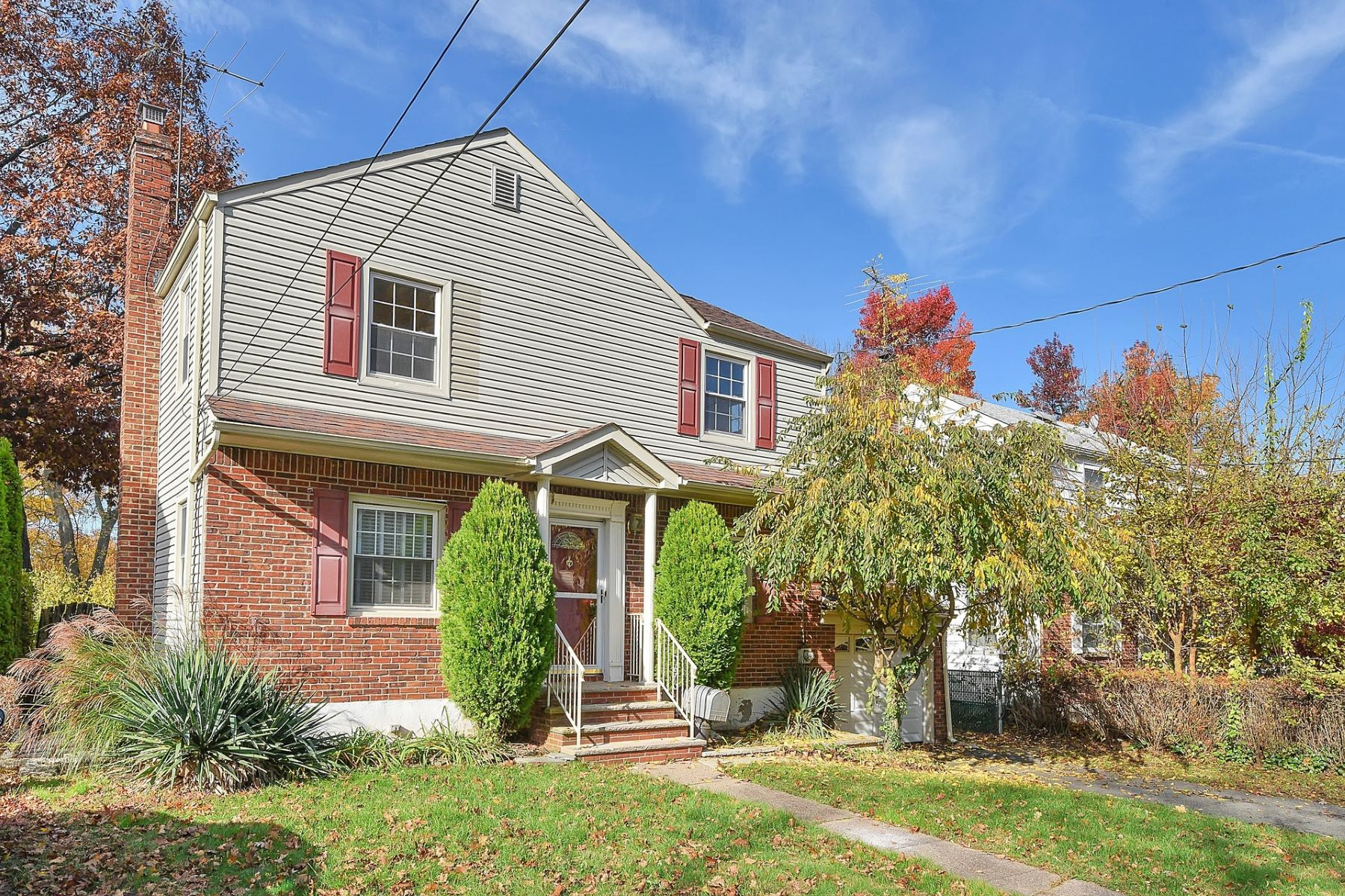 Single Family Home for Sale at Center Hall Colonial 24 Hillcrest Drive, Dumont, New Jersey 07628 United States