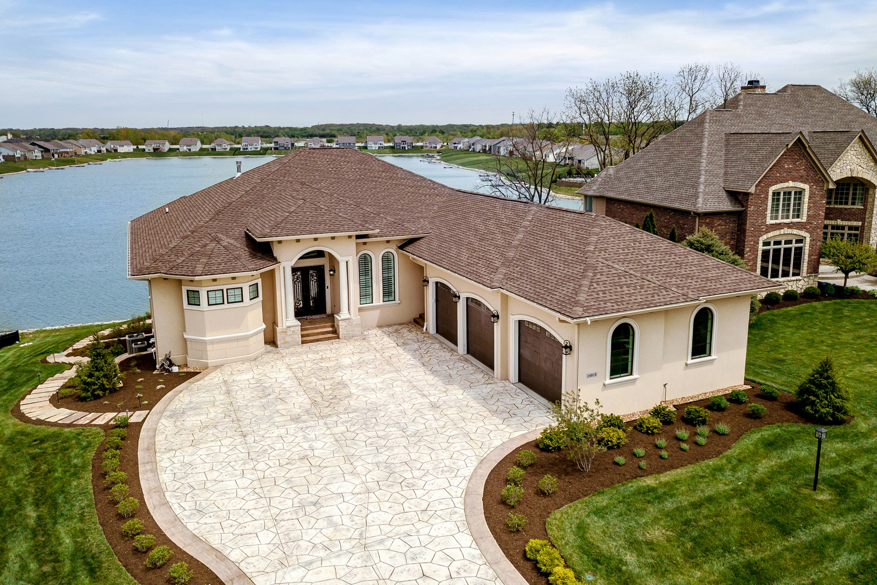 Single Family Homes for Active at Elegant, Lakefront Home 14916 Braemar Avenue E Indianapolis, Indiana 46062 United States