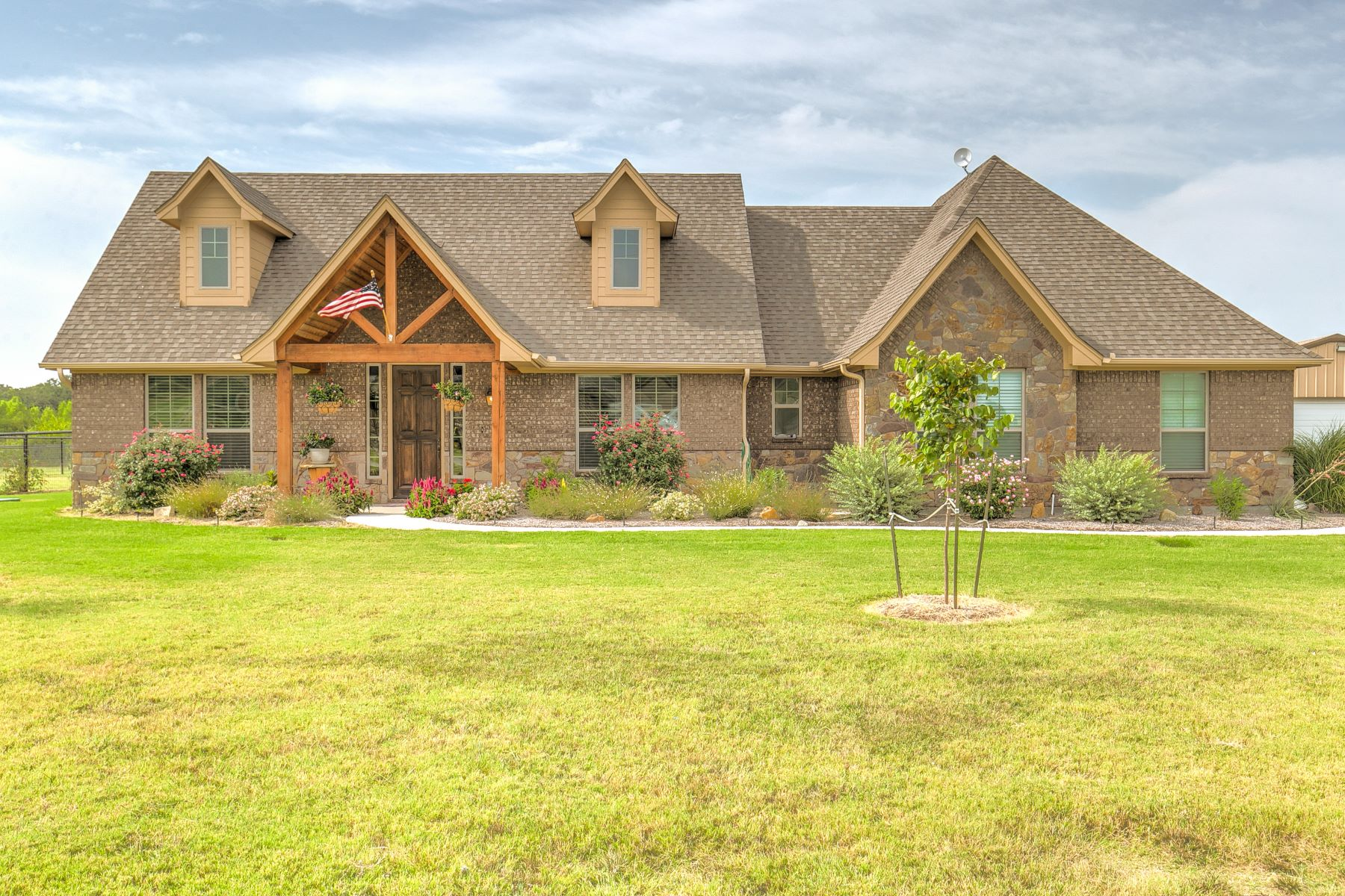 Single Family Homes for Sale at Farmhouse style home has everything needed for a little country living 173 Lavender Lane Springtown, Texas 76082 United States