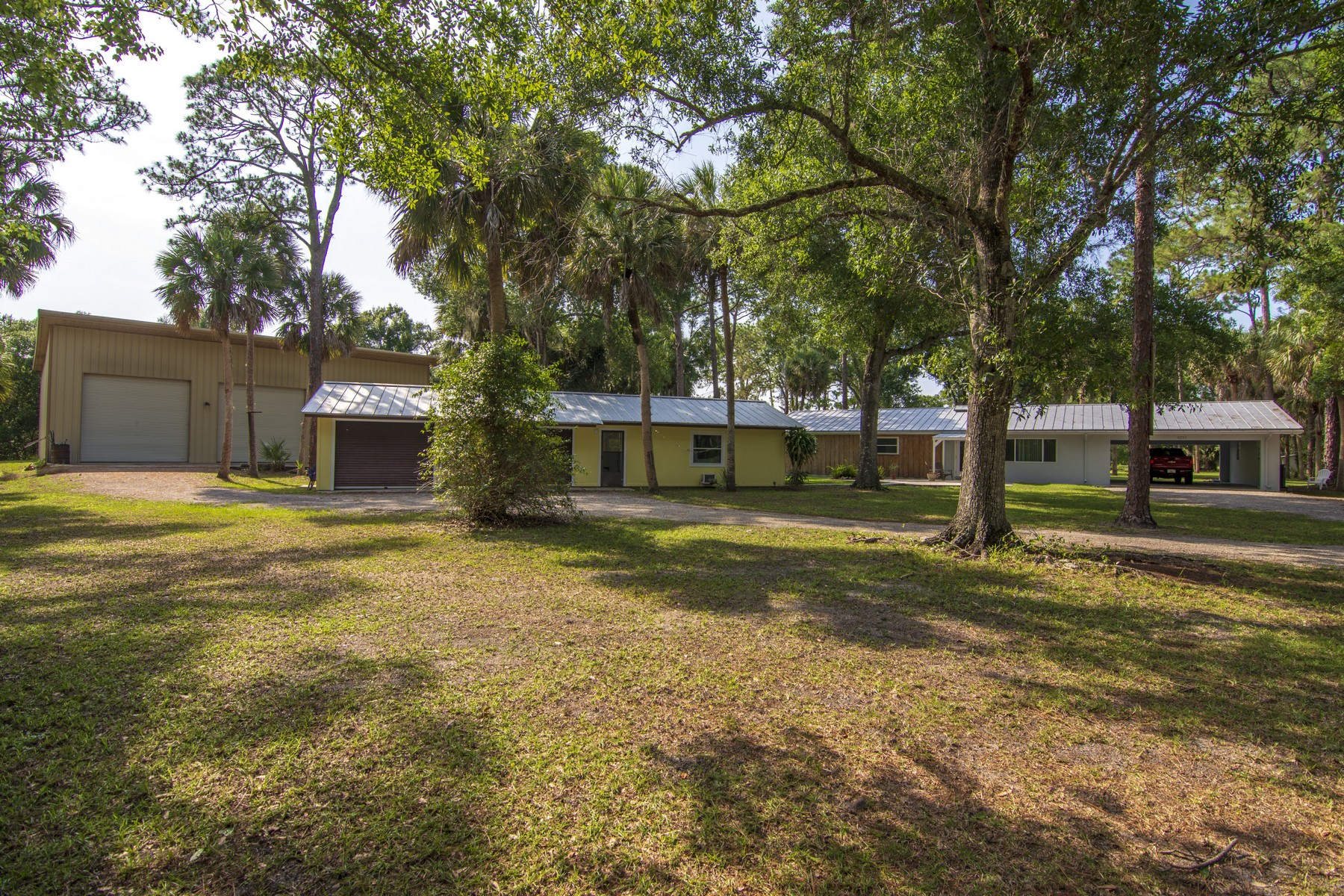 single family homes for Sale at Country Paradise on 5.31 Acres, Two Workshops 6250 47th St Vero Beach, Florida 32967 United States