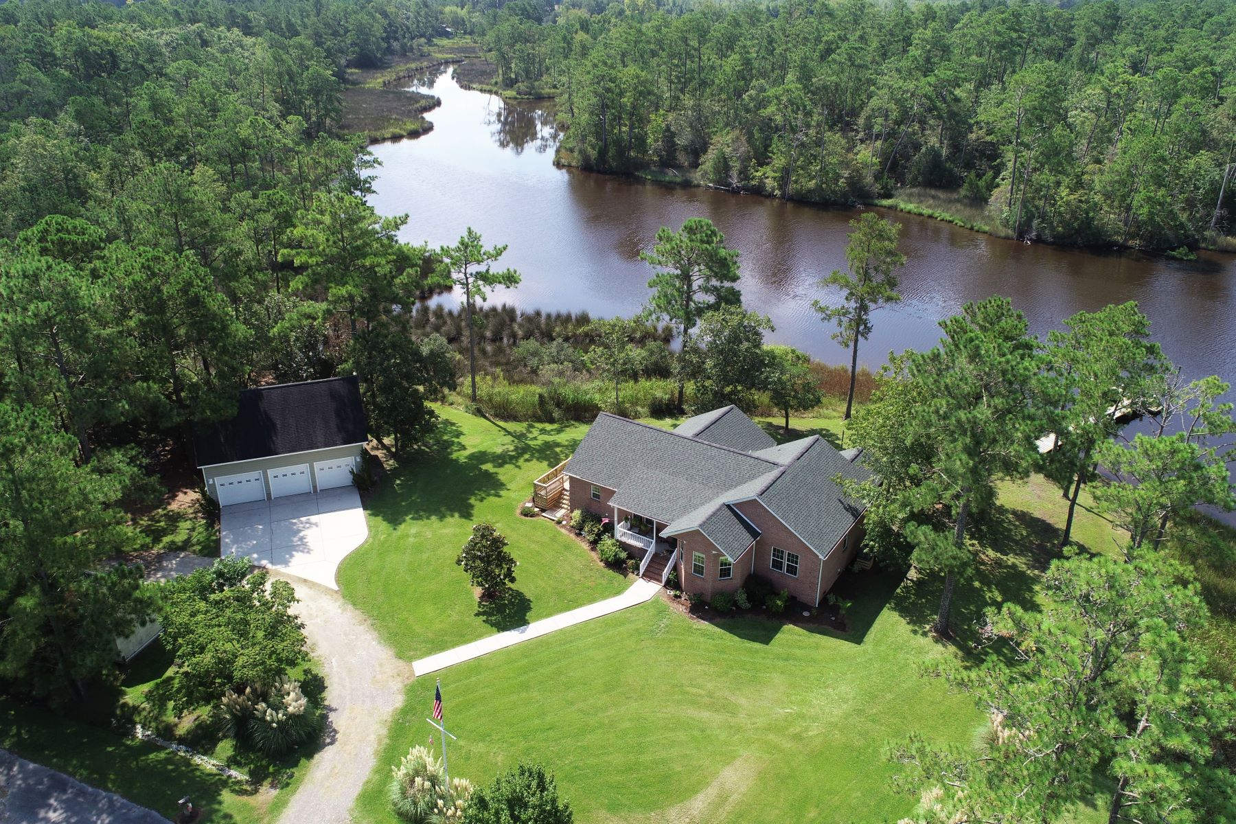 Single Family Homes for Sale at Attractive Waterfront Home 201 Trawler Lane Merritt, North Carolina 28556 United States