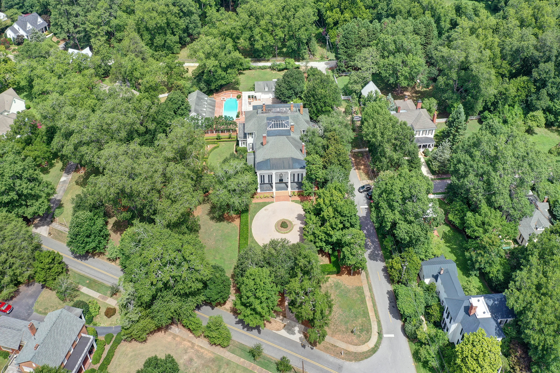 Single Family Homes for Active at Circa 1835 Colonial Revival Masterpiece on 4 +/- Acres 617 Dixie Avenue Madison, Georgia 30650 United States