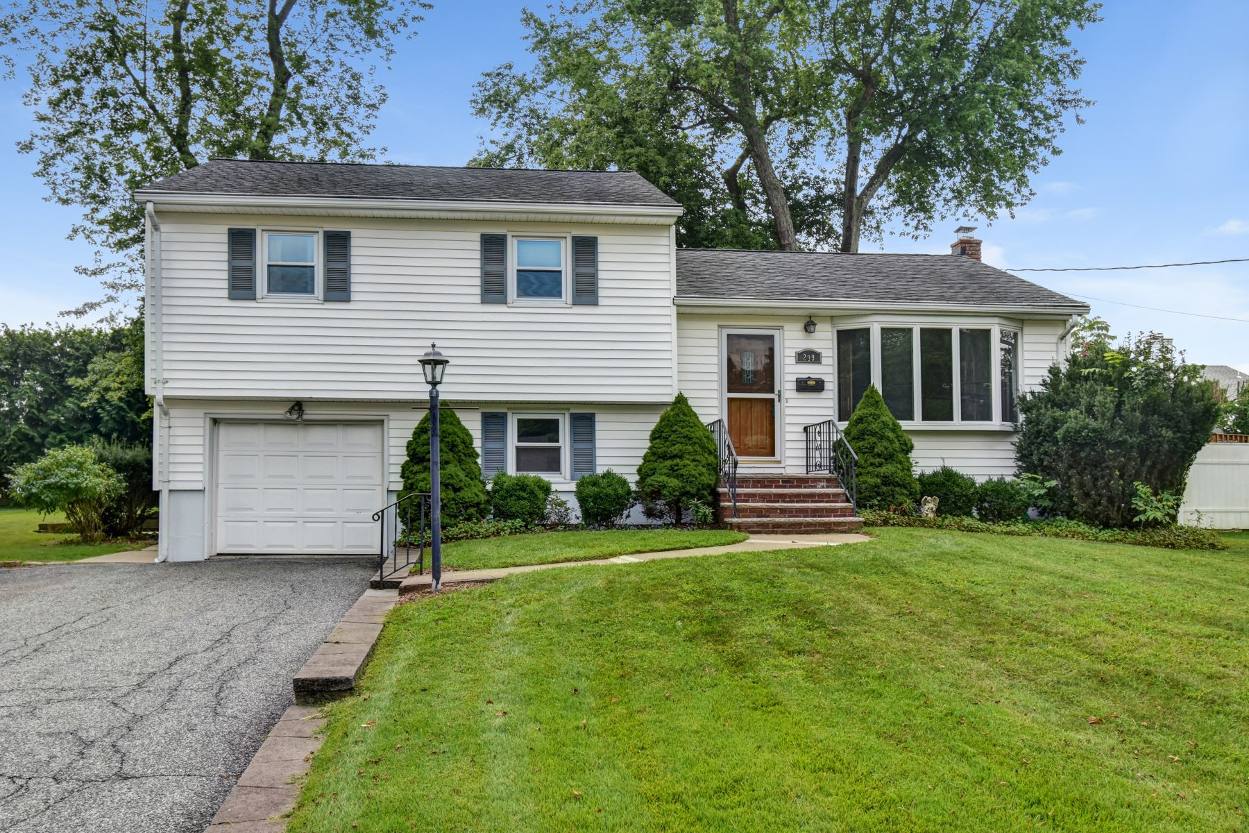 Single Family Homes for Sale at Split Level on Beautiful Lot 299 Garfield Street Berkeley Heights, New Jersey 07922 United States