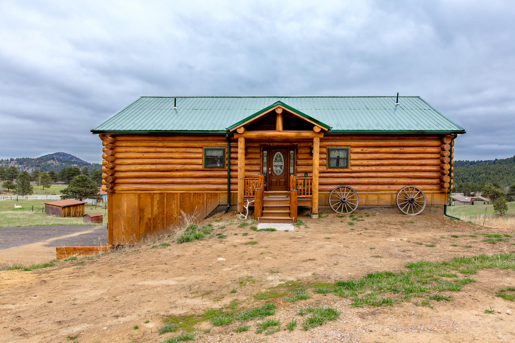Single Family Homes for Sale at You will love this beautiful custom built log home 6832 Peaceful Hills Rd, Morrison, Colorado 80465 United States