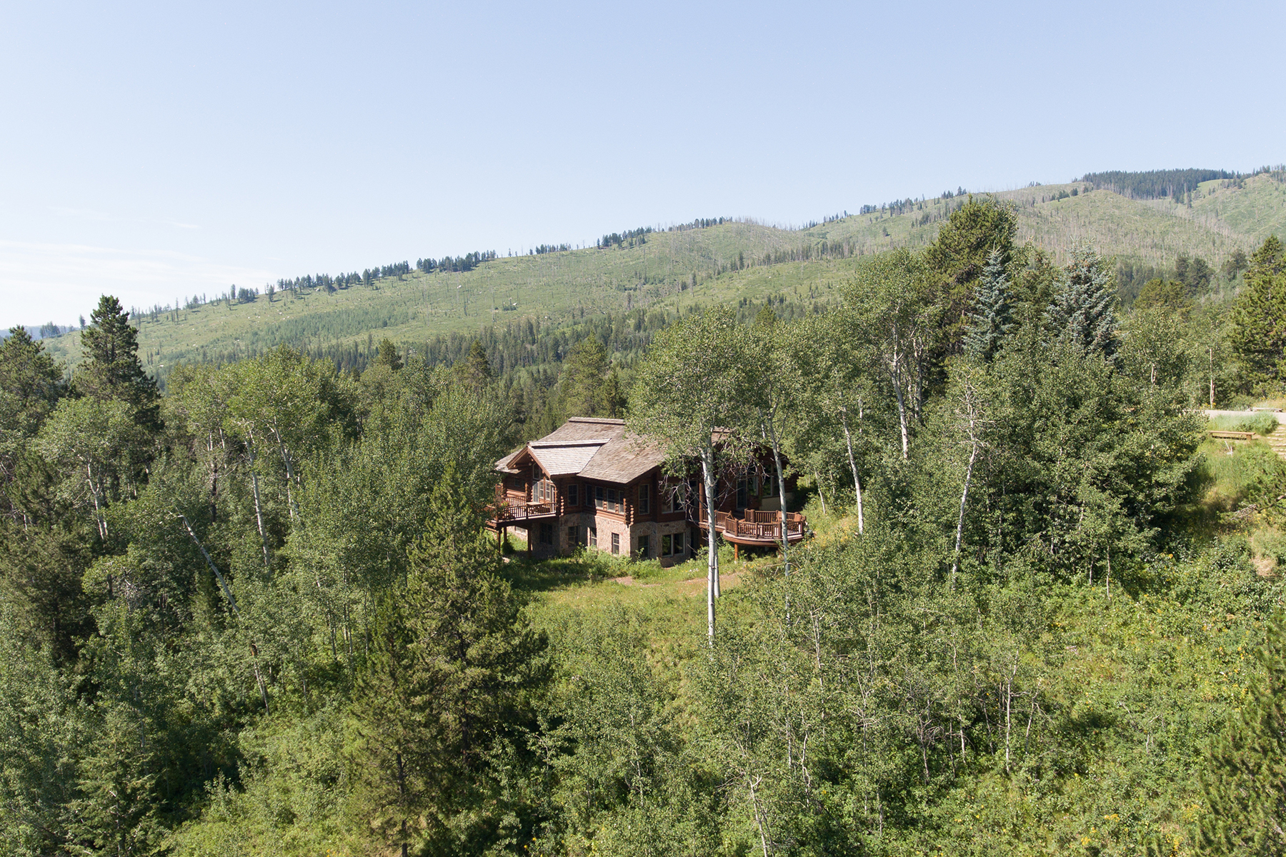 Single Family Homes pour l Vente à Crescent H home with spectacular views 880 S Crescent H Road, Wilson, Wyoming 83014 États-Unis